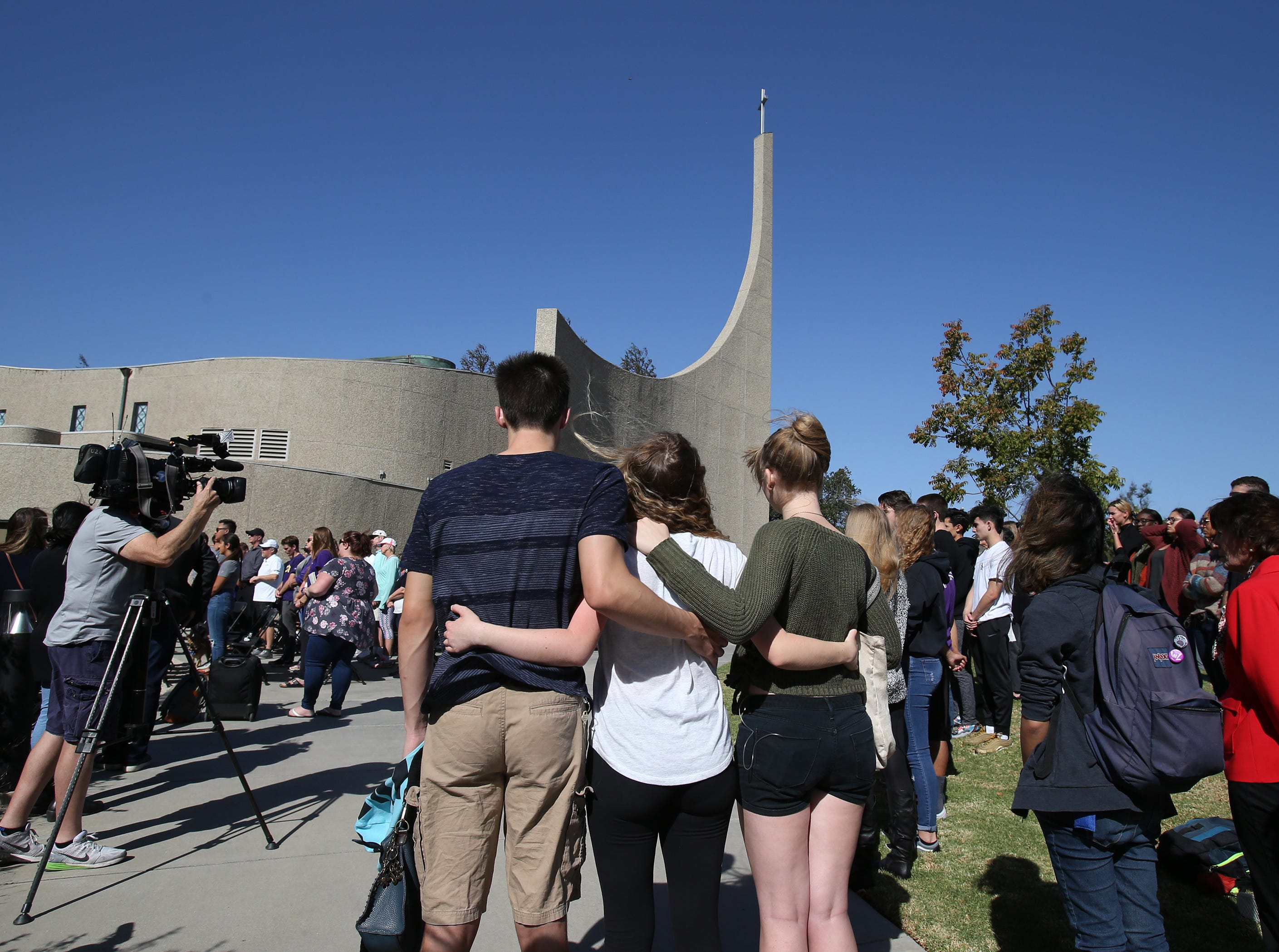 Cal Lutheran students hug each other during the service Thursday held for the victims of the Borderline Bar Borderline Bar & Grill shooting.