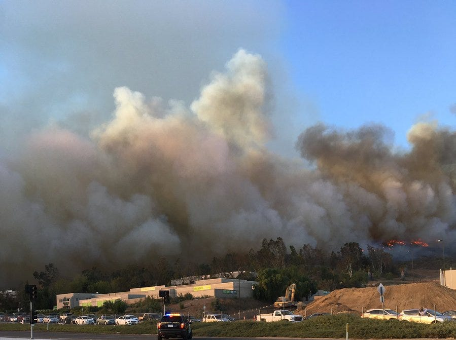 Smoke from the Hill Fire burns in the Santa Rosa Valley billows up into the sky Thursday afternoon.