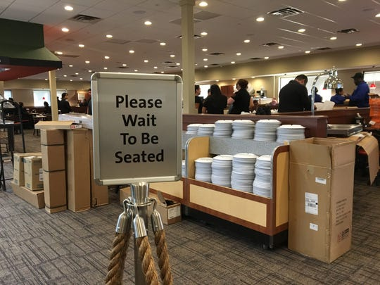 """A """"please wait to be seated"""" sign is among the pieces of equipment already in place as employees prepare for the opening of Golden Corral in Oxnard."""