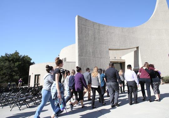 Cal Lutheran students, faculty and members head for the university's chapel for a service Thursday held for the victims of the Borderline Bar Borderline Bar & Grill shooting.