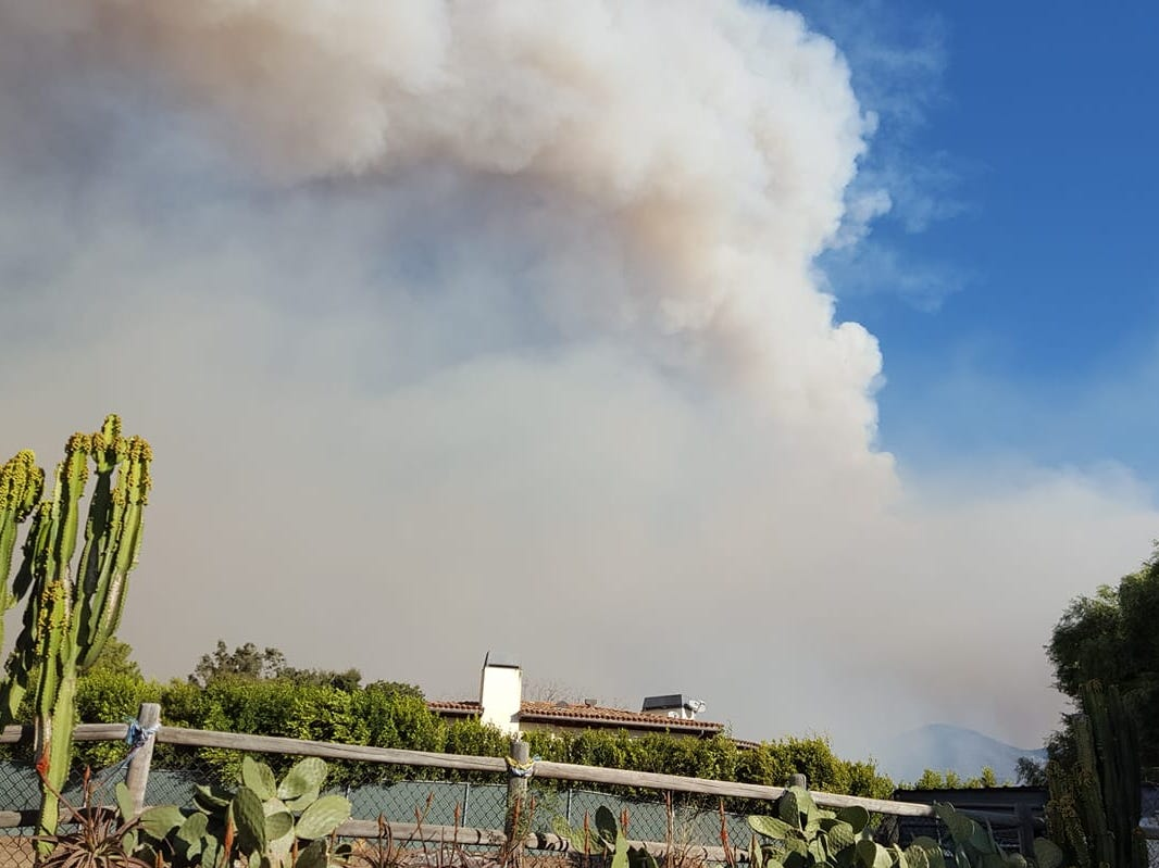 Smoke can be seen in Malibu from the Woolsey Fire on Friday.