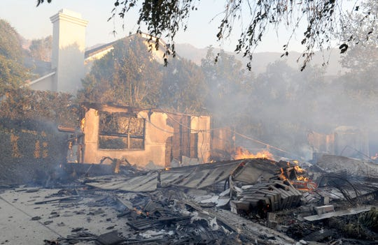 A house was destroyed on Lafitte Drive in Oak Park as the Woolsey Fire swept through the Conejo Valley on Friday.