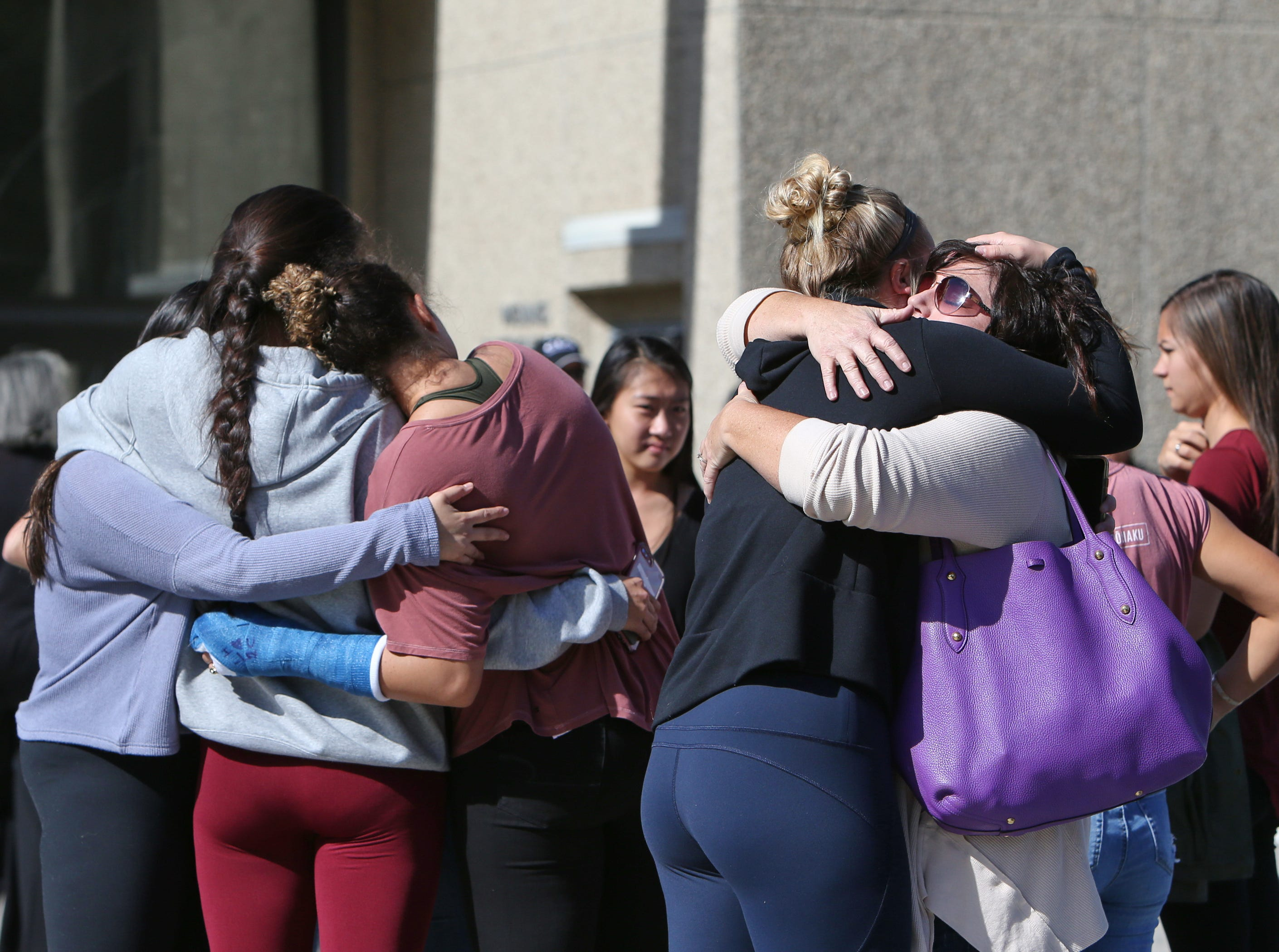 Cal Lutheran students, faculty and community members console each other after the service Thursday for the victims of the Borderline Bar Borderline Bar & Grill shooting.