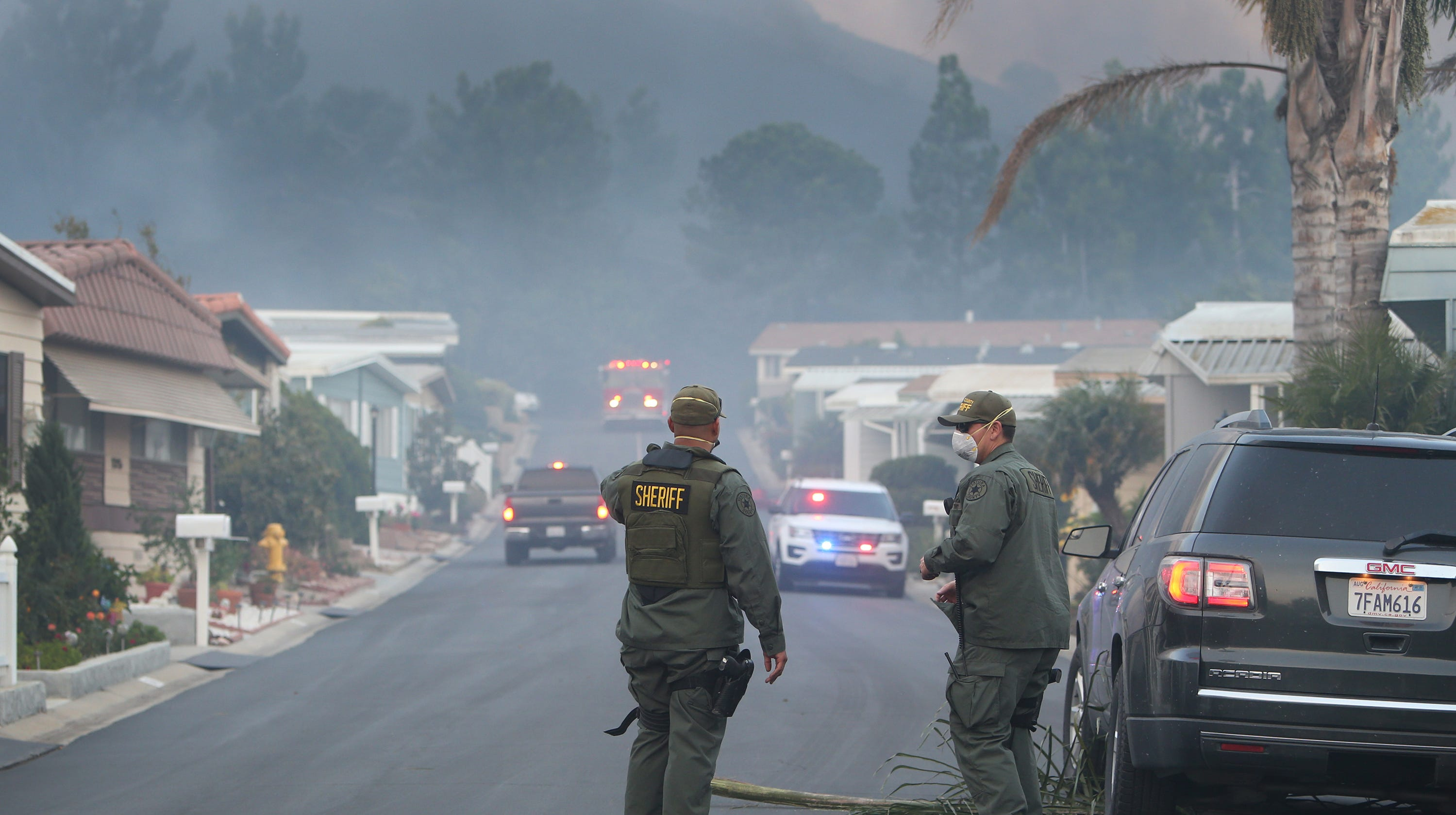 Ventura County Sheriff officers work on evacuating residents from a mobile home park off Old Conejo Road in Newbury Park.