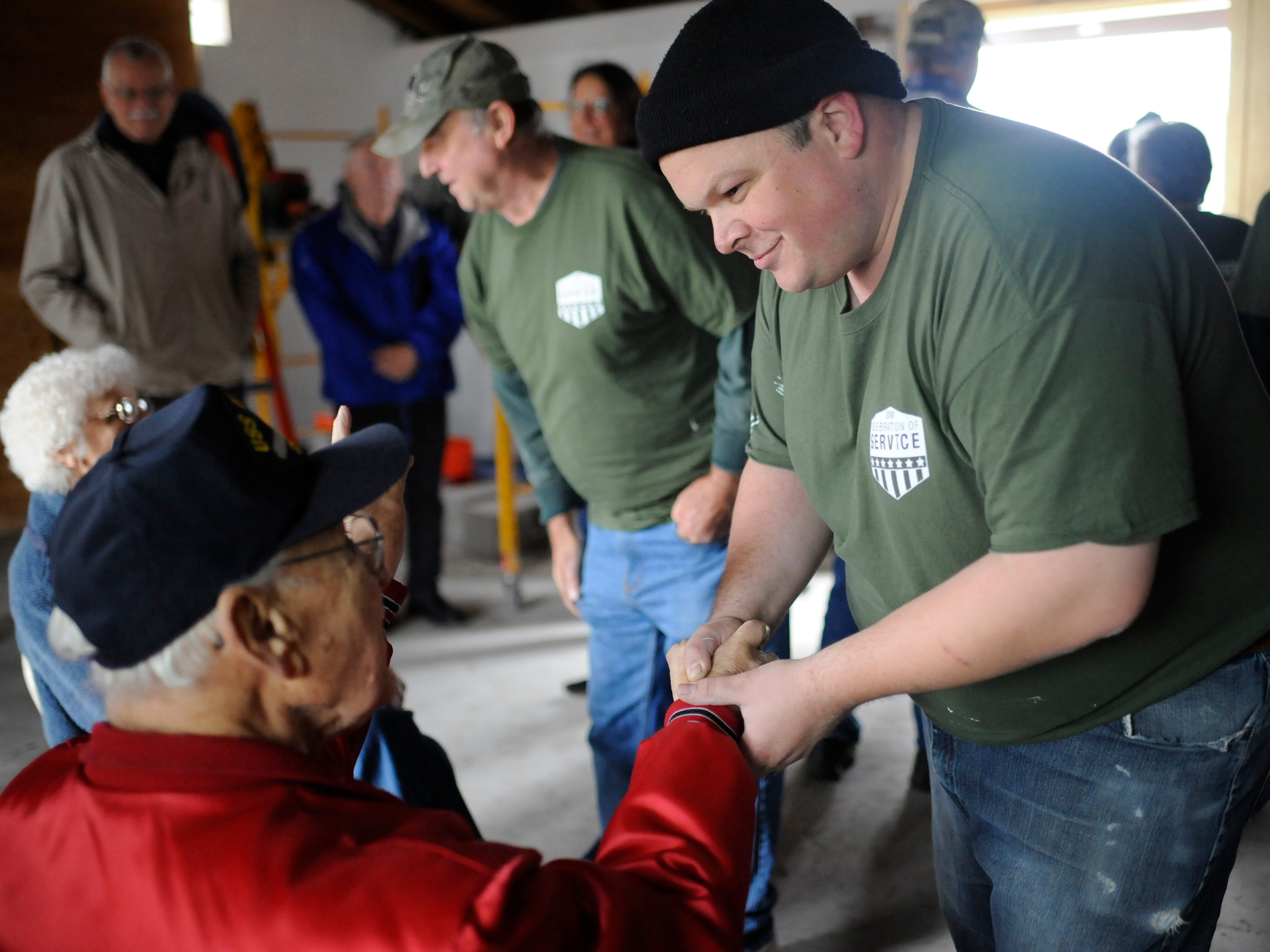 Steven England, Vineland Home Depot assistant manager and community captain, shakes the hand of Owen Garrison, a 93-year-old WWII Navy Veteran and Millville Army Airfield Museum volunteer during a building renovation event on Friday, November 9, 2018.