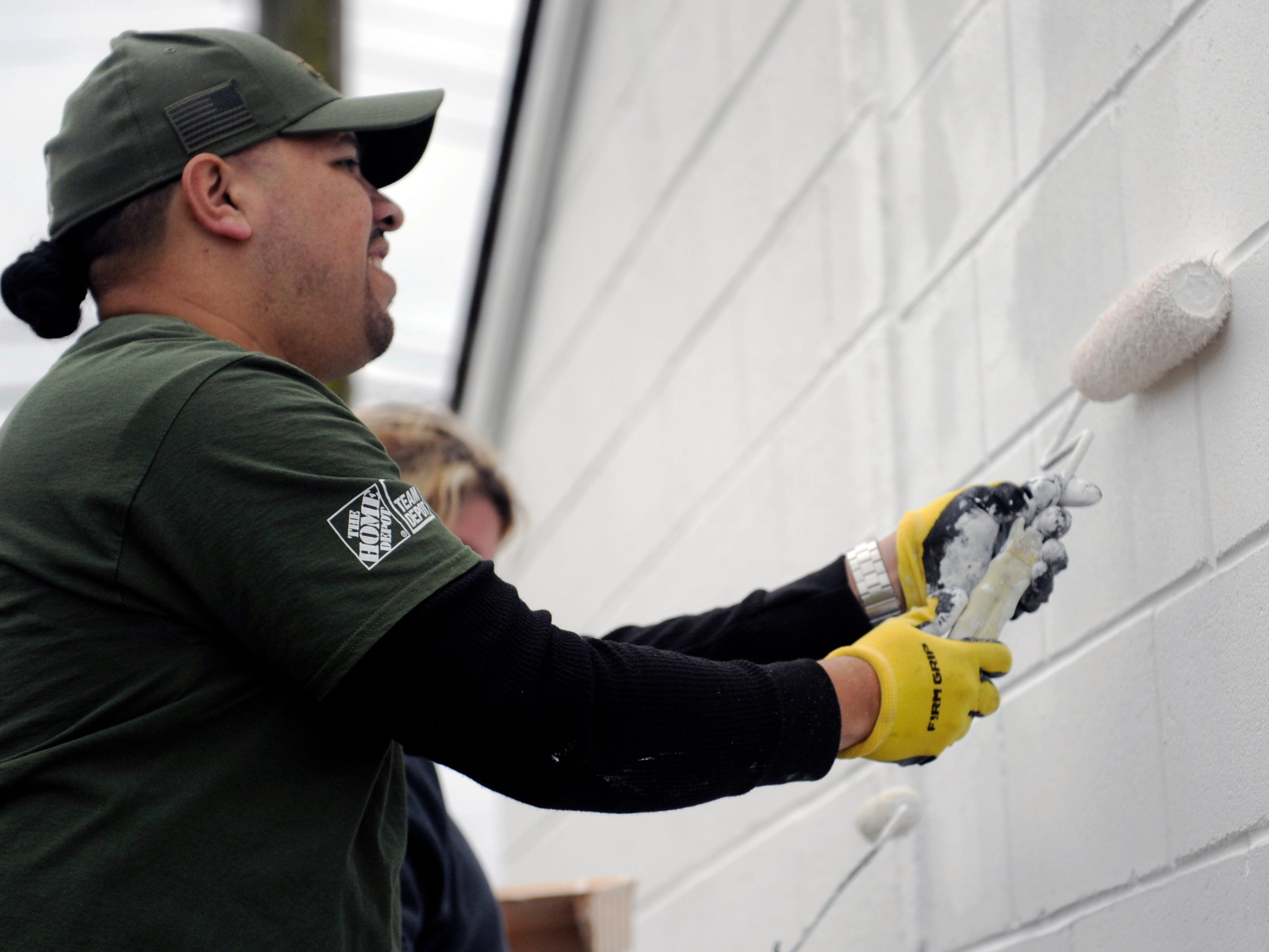 Oscar Alvarado, Lawnside Home Depot overnight supervisor, helps paint a wall during a special building renovation event at Millville Army Airfield Museum on Friday, November 9, 2018.