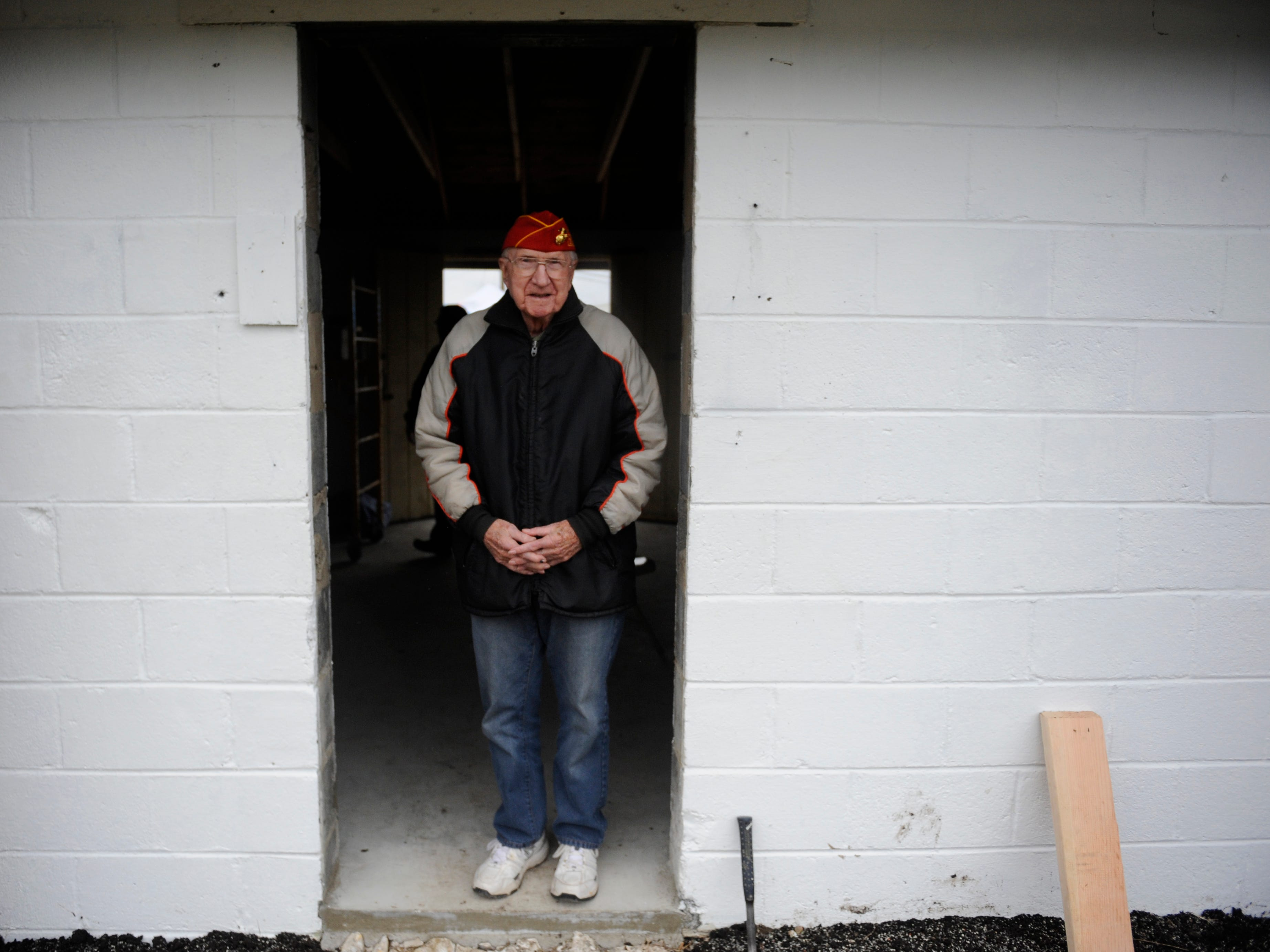 Walter S. Kocielski, a 92-year-old WWII Marine Veteran and Millville Army Airfield Museum volunteer watches the Home Depot team help renovate a building during a special event on Friday, November 9, 2018.