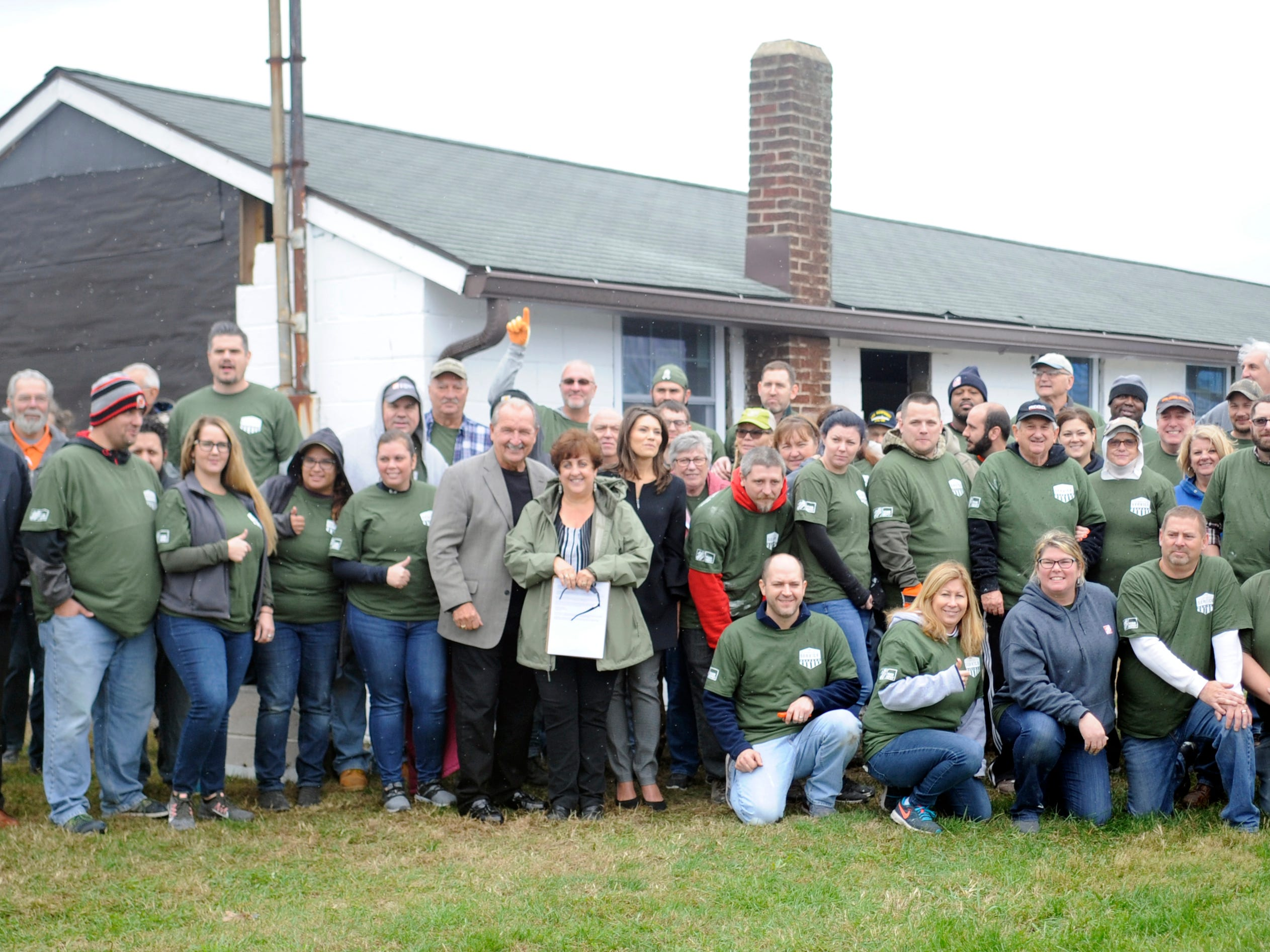 Members of the Home Depot team, Millville Army Airfield Museum staff and Millville City officials pose for a group photo during a special building renovation event on Friday, November 9, 2018.