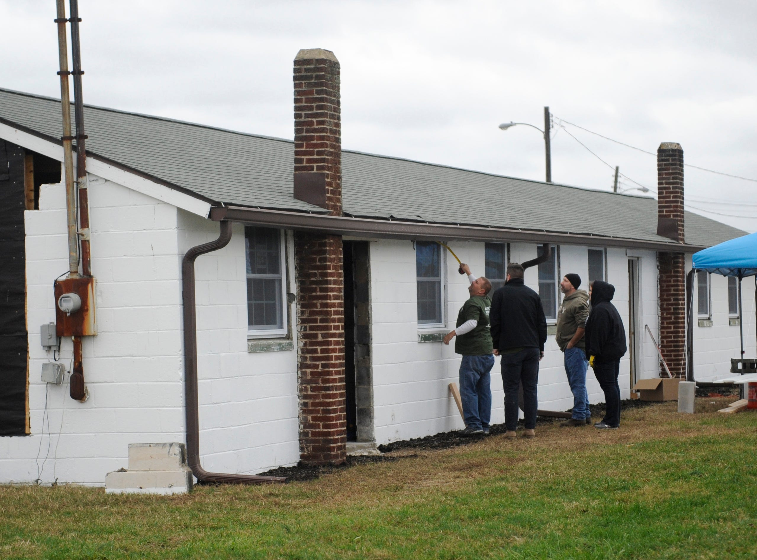 Members of the Home Depot team help renovate a building that will be part of the Millville Army Airfield Museum on Friday, November 9, 2018.