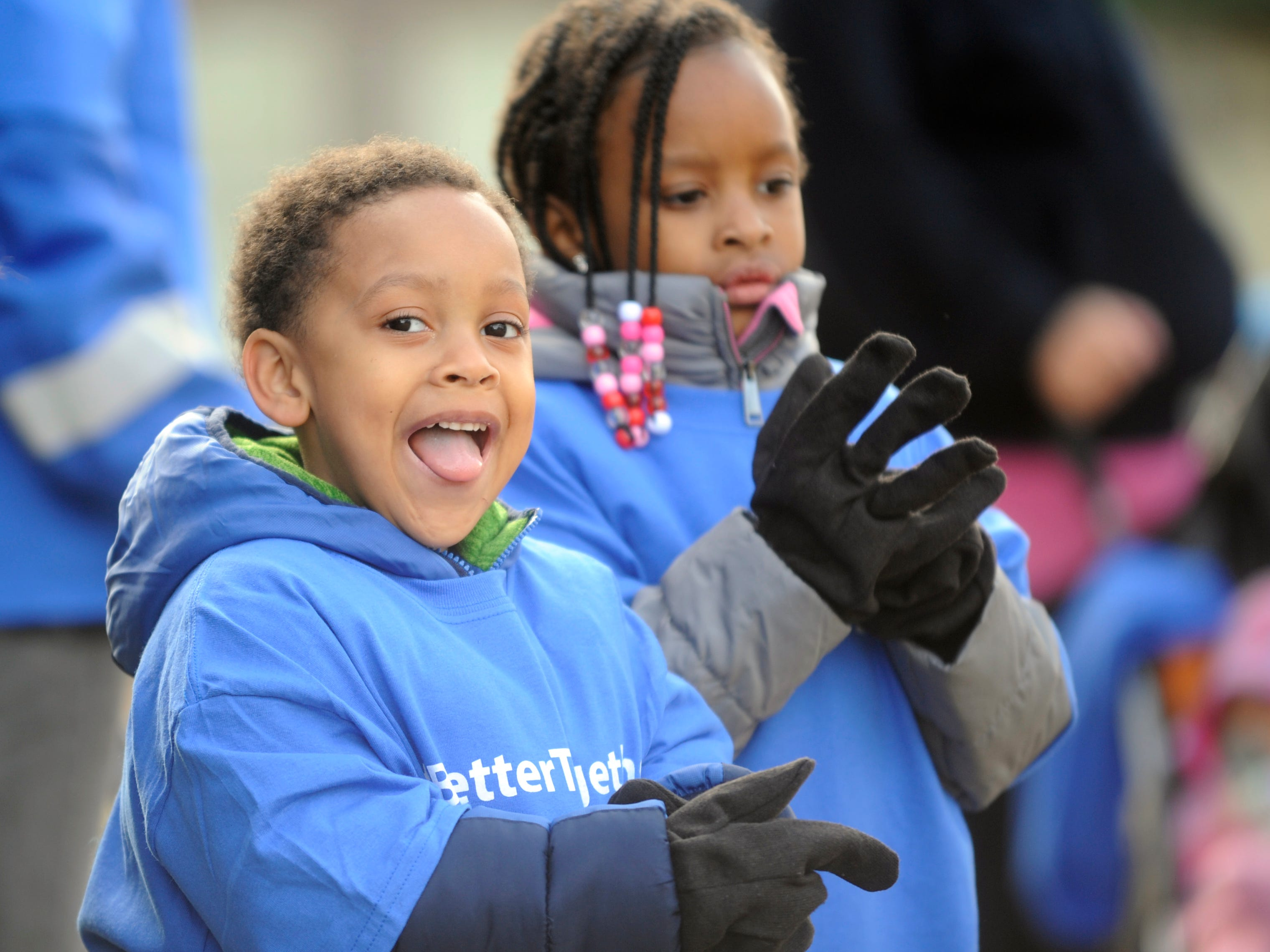 Oakview Apartments residents Jibril Alsobrook, 4, and sister Saleya, 6, get ready to put away trash during a community clean up event in Millville on Thursday, November 8, 2018.