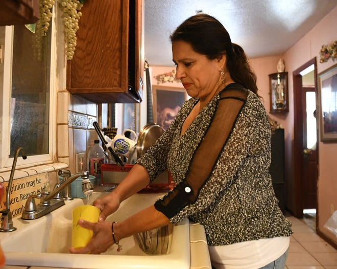 After years without clean drinking water, even the drudgery of dish-washing is a blessing for Lucy Hernandez.