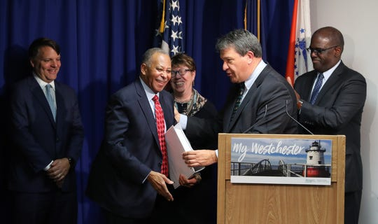 Westchester County Executive George Latimer, right delivers his proposed budget for 2019 to Ben Boykin, the chairman of the Westchester County Board of Legislators, at the Michaelian Office Building in White Plains, Nov. 9, 2018.