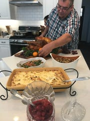 Rick Rodgers puts the final touches on a Thanksgiving feast made in his Sussex County kitchen.
