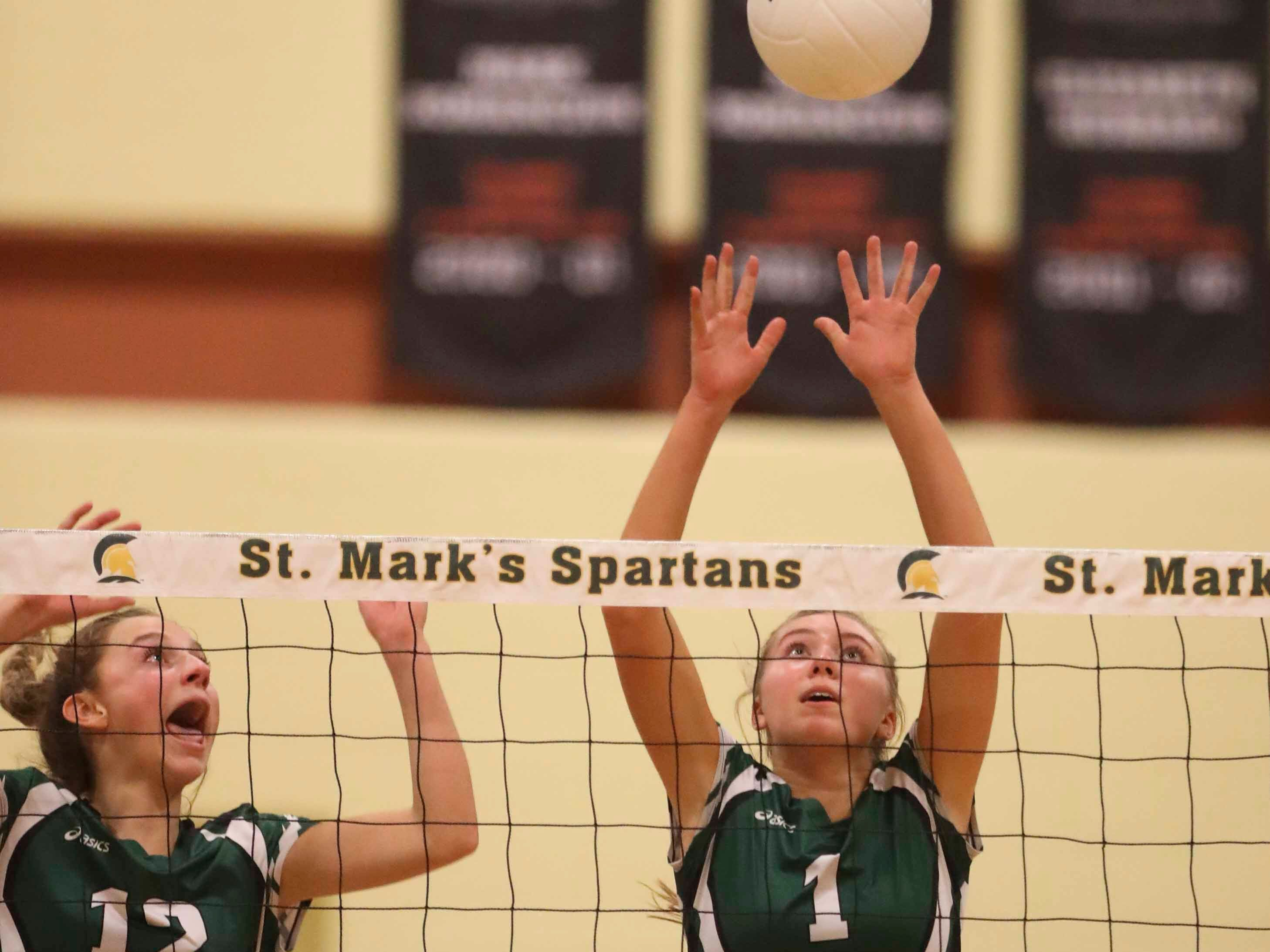 Archmere's Abigail Kates (left) and Julia Kochie work at the net on defense as the Auks advance to Monday's final in the DIAA state tournament Thursday at St. Mark's High School.