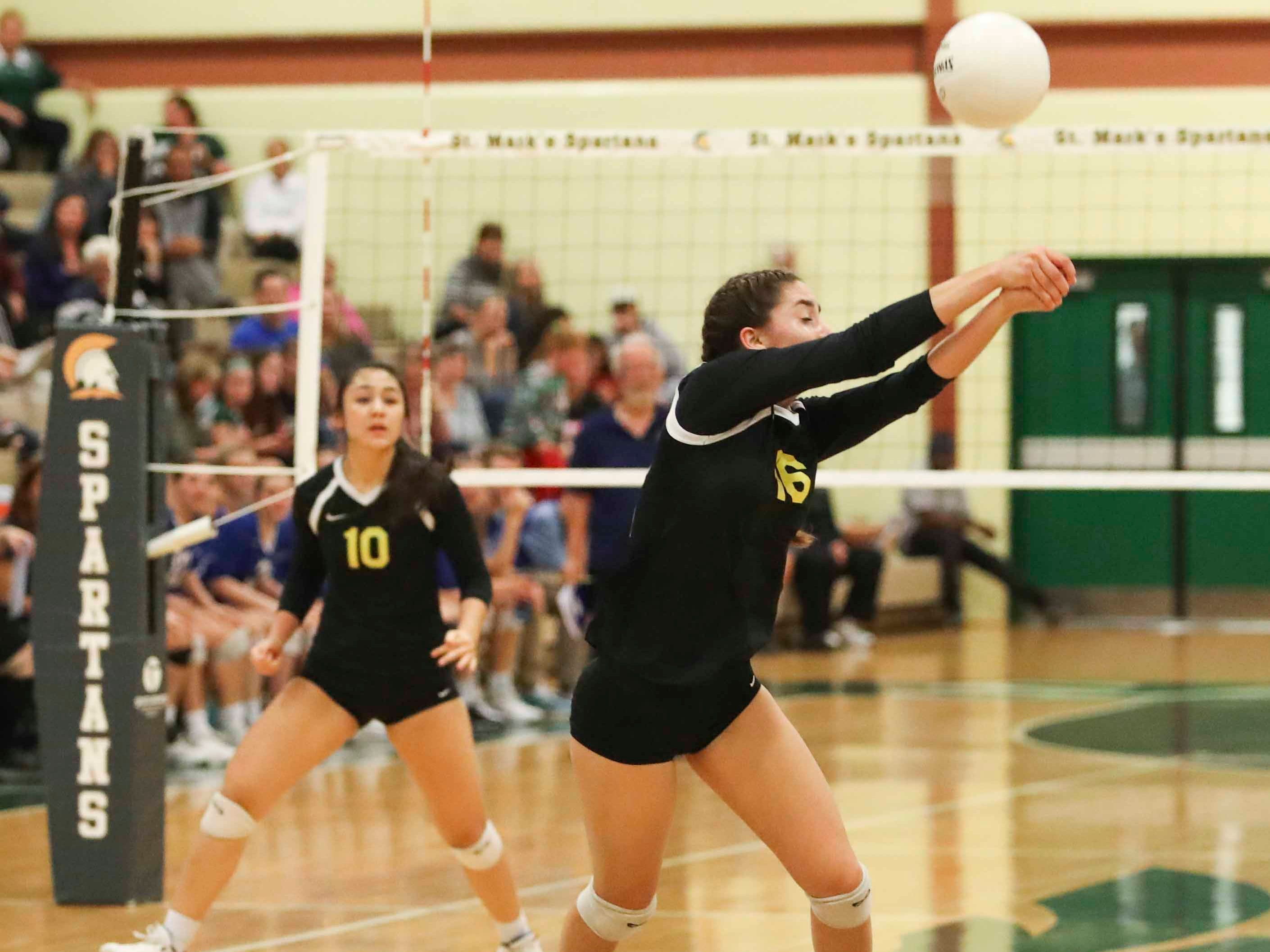 Padua's reahes for a dig as the Force advances to Monday's final in the DIAA state tournament Thursday at St. Mark's High School.