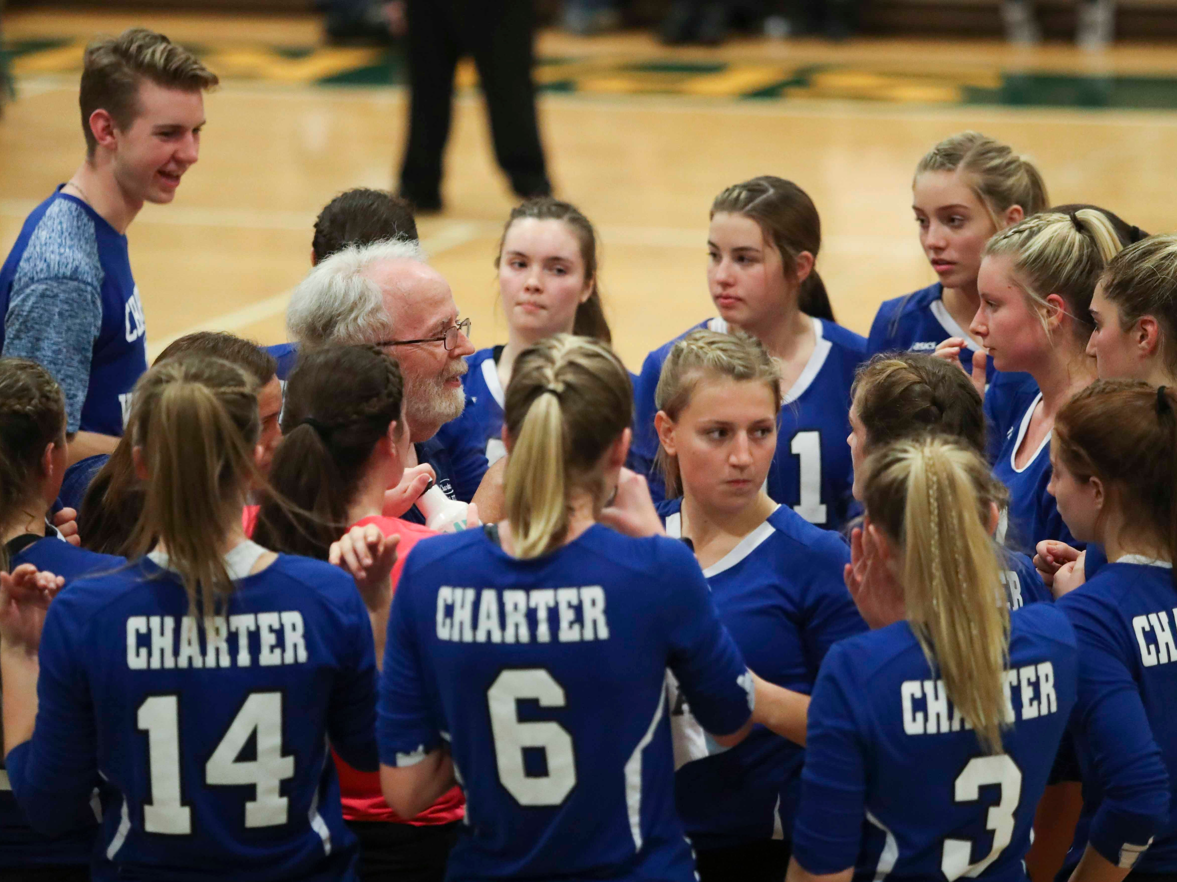 Charter School of Wilmington head coach Dave Stover gathers his team in a timeout as the Force nears advancing to Monday's final in the DIAA state tournament Thursday at St. Mark's High School.