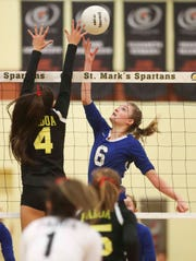 Charter School of Wilmington's Madeline Matheny (right) tries to hit past Padua's Jacqueline Camponelli.