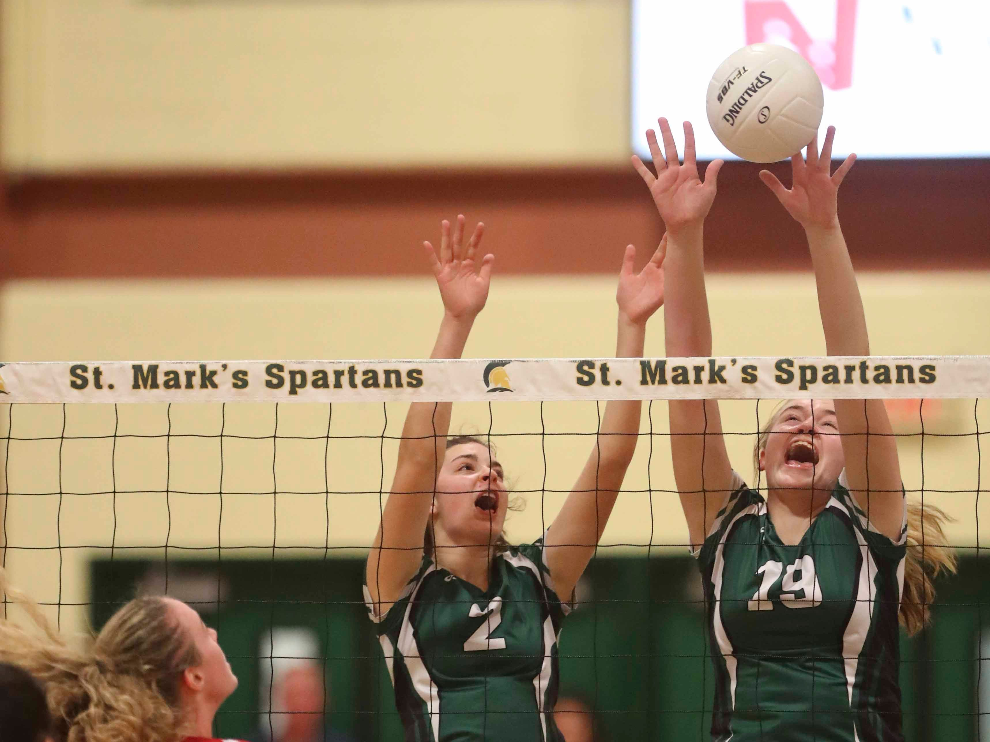 Archmere's Faith Merritt (2) and Lauren Edmiston defend at the net as the Auks advance to Monday's final in the DIAA state tournament Thursday at St. Mark's High School.