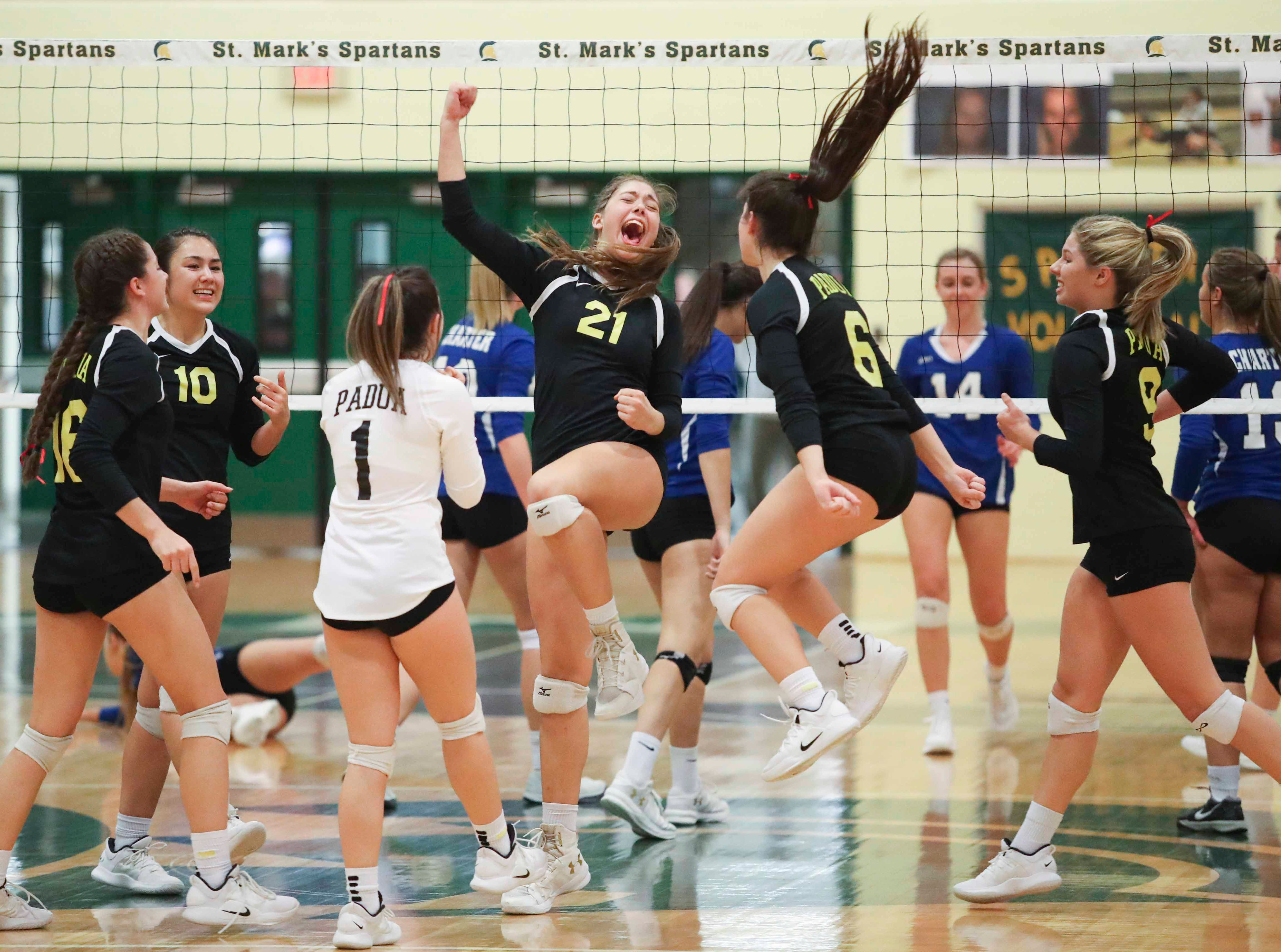 Padua's Michelle Kozicki (21) and Audrey Lyons (6) join their teammates after a point as the Force eventually advances to Monday's final in the DIAA state tournament Thursday at St. Mark's High School.