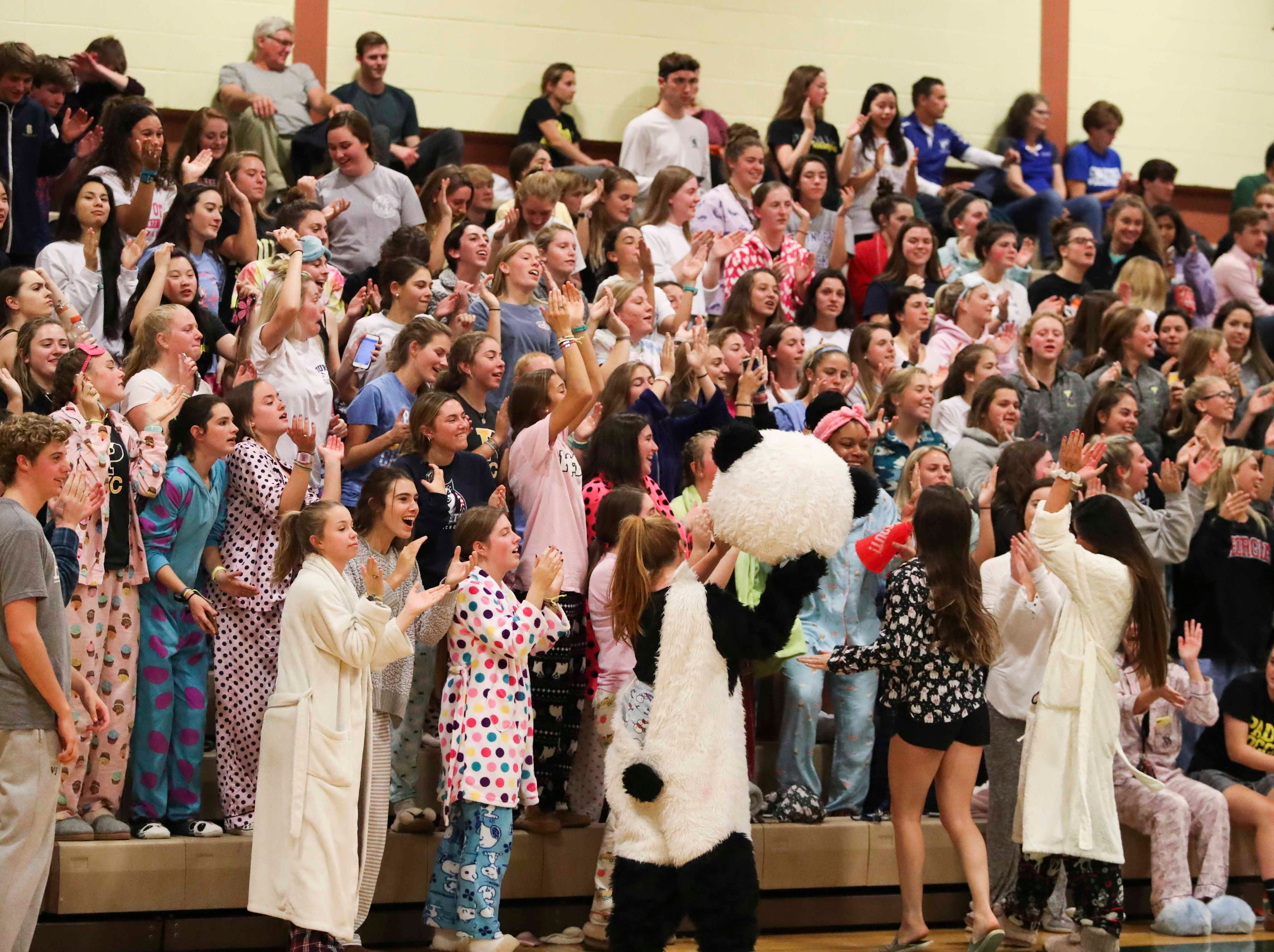 Fans in the Padua student section cheer before the Force advances to Monday's final in the DIAA state tournament Thursday at St. Mark's High School.