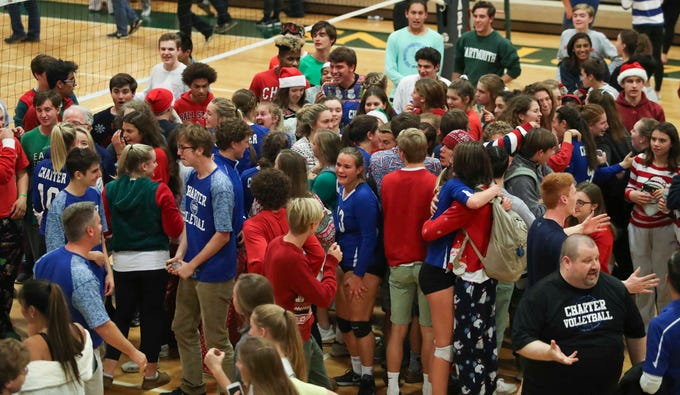 Students mingle with schoolmates on Charter School of Wilmington's winning team as the Force advances to Monday's final in the DIAA state tournament Thursday at St. Mark's High School.