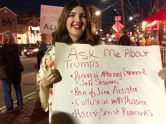 Mallory Shover, 17, joined over 100 protesters Thursday evening on Main Street in Newark to speak out against President Trump and his stance on transgender rights.