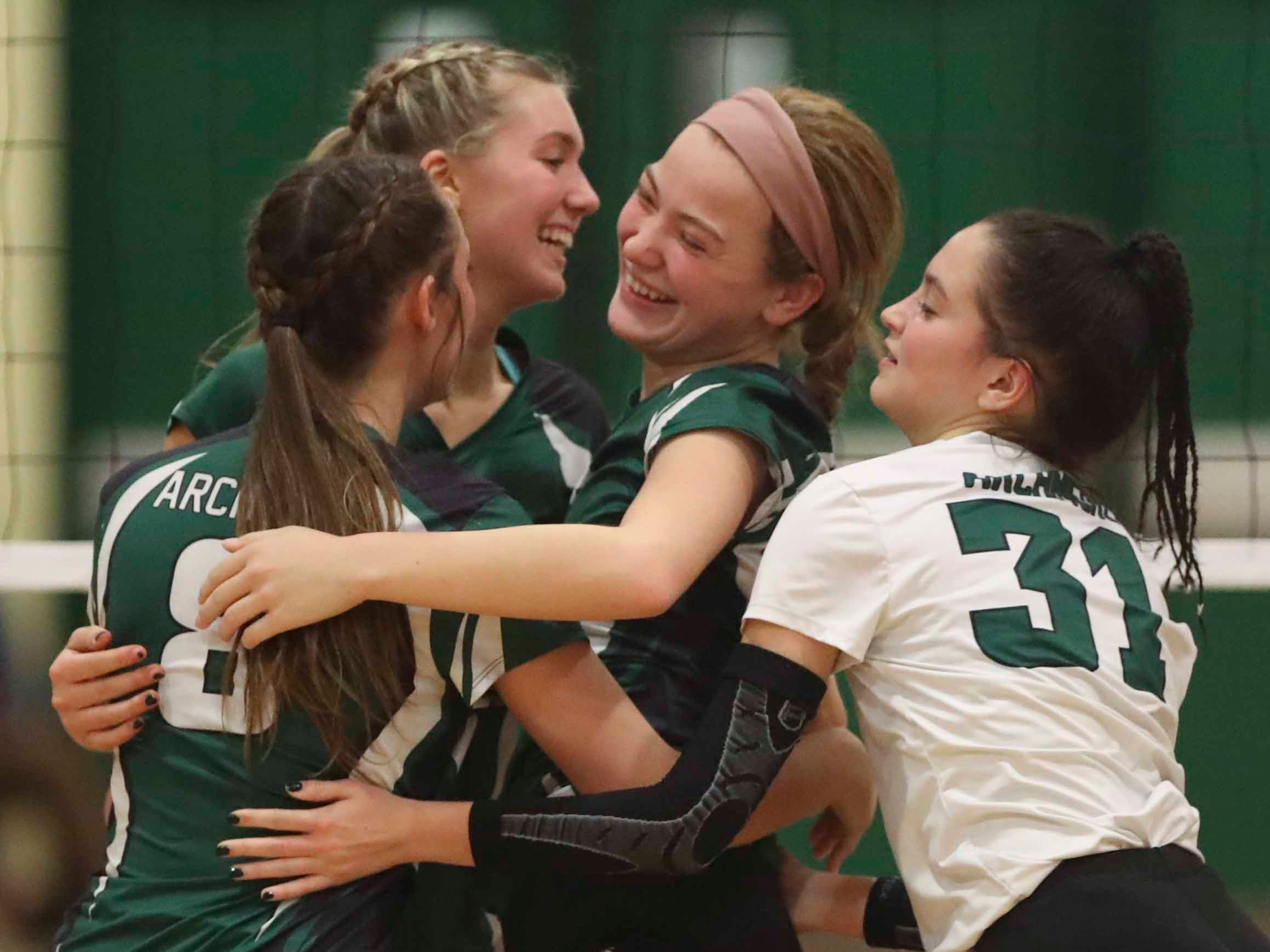 Archmere's (from left)  Mackenzie Popp, Julia Kochie, Sydney Niumataiwalu and Hannah Wright come together after a successful point as the Auks advance to Monday's final in the DIAA state tournament Thursday at St. Mark's High School.