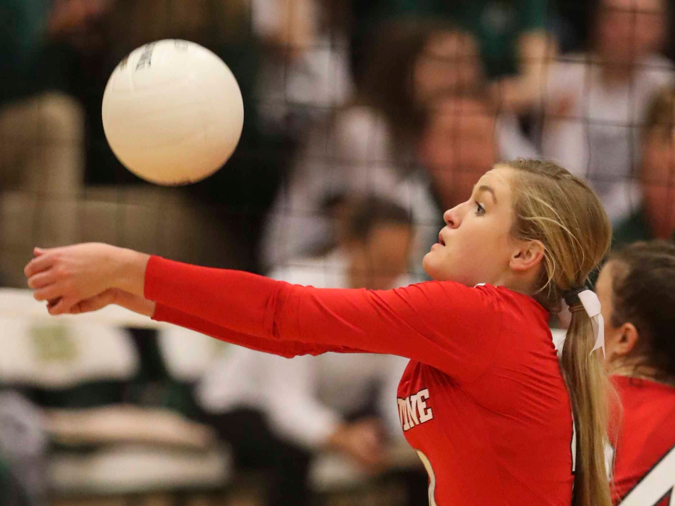 Ursuline's Cassidy Markel digs as the Auks advance to Monday's final in the DIAA state tournament Thursday at St. Mark's High School.