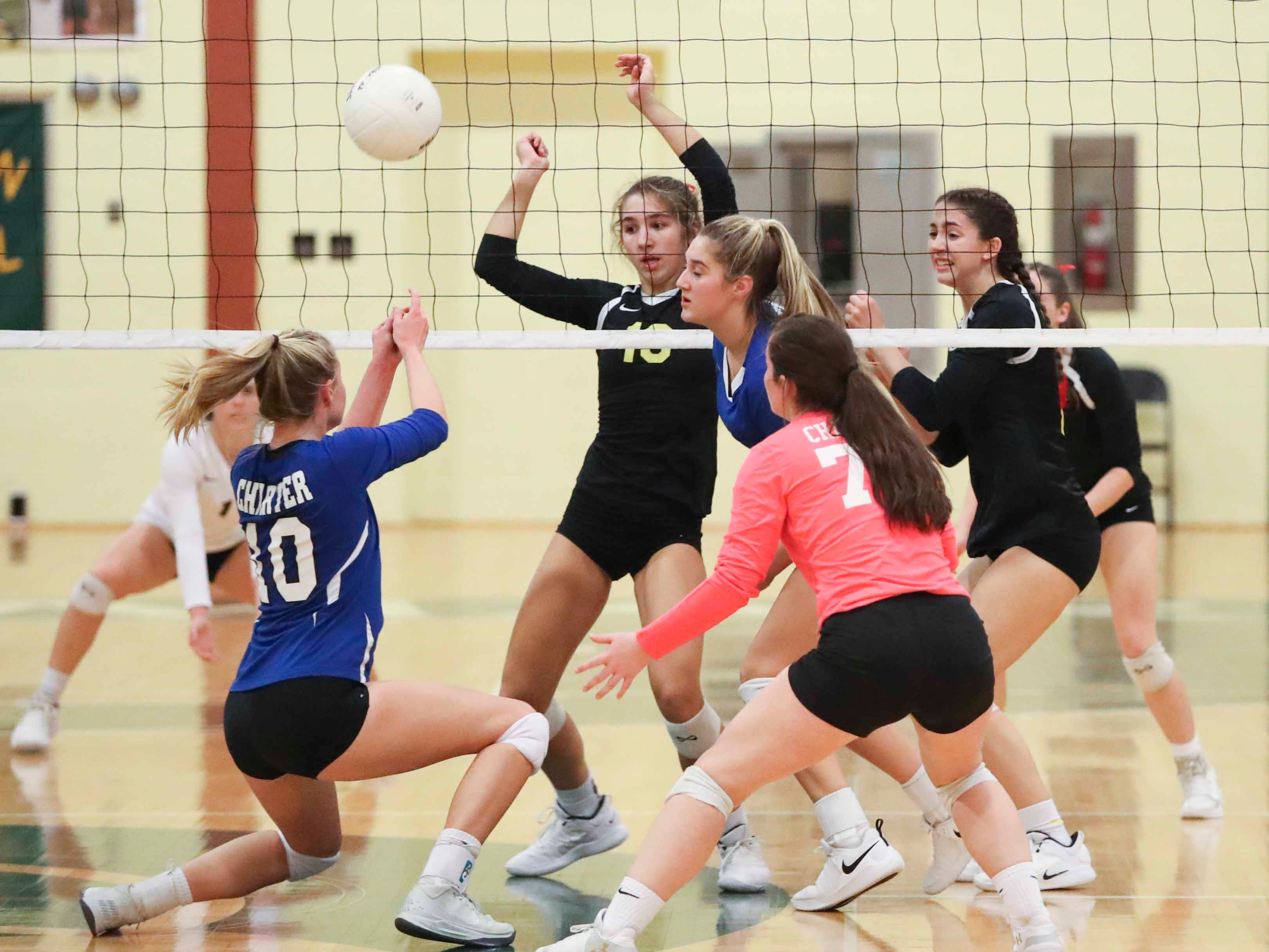 Charter School of Wilmington's Kennie Swanson (10) keeps a point alive as the Force advances to Monday's final in the DIAA state tournament Thursday at St. Mark's High School.