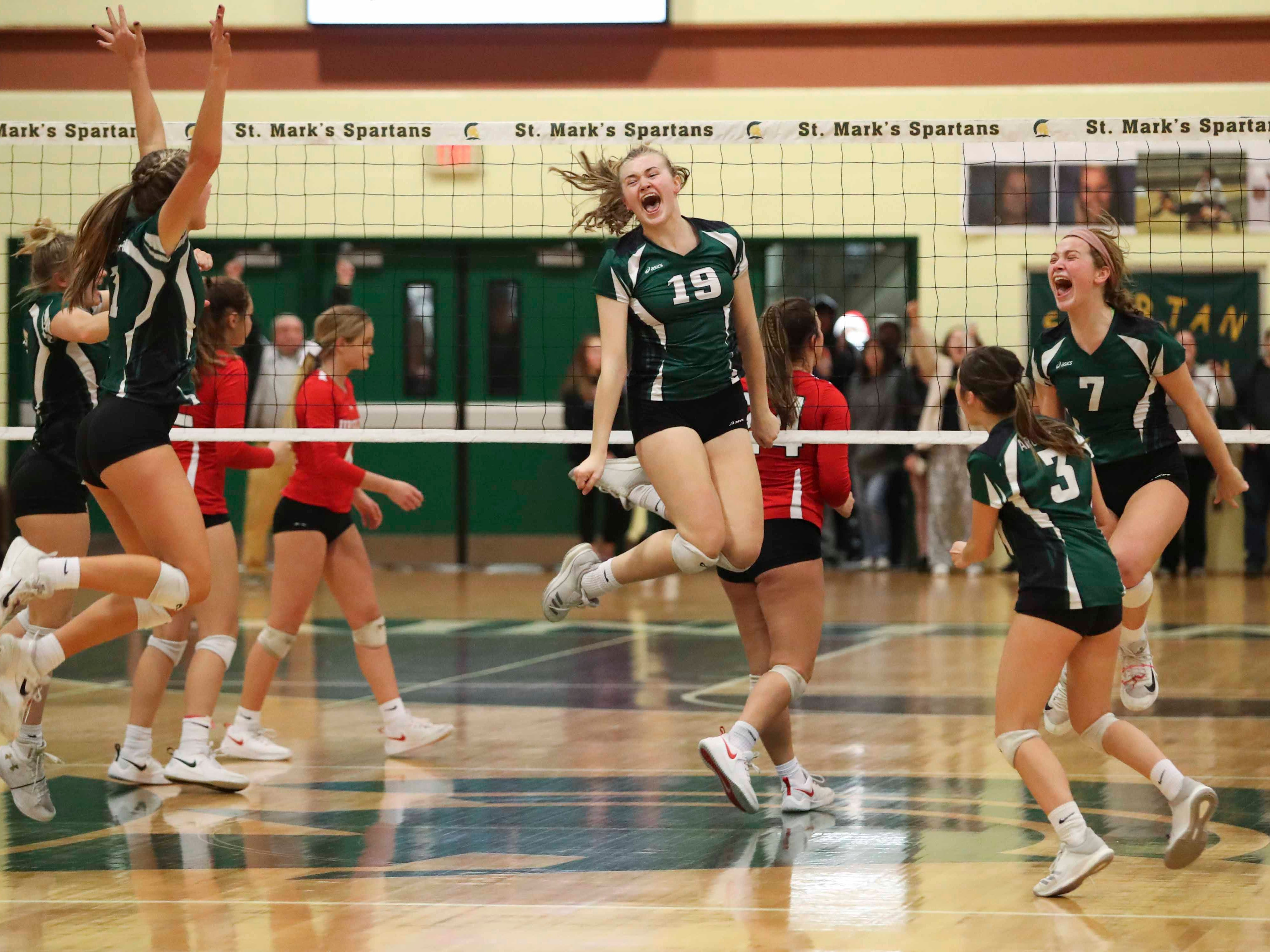 Archmere's Lauren Edmiston (19) and the rest of the Auks react after the final point as Archmere advances to Monday's final in the DIAA state tournament Thursday at St. Mark's High School.