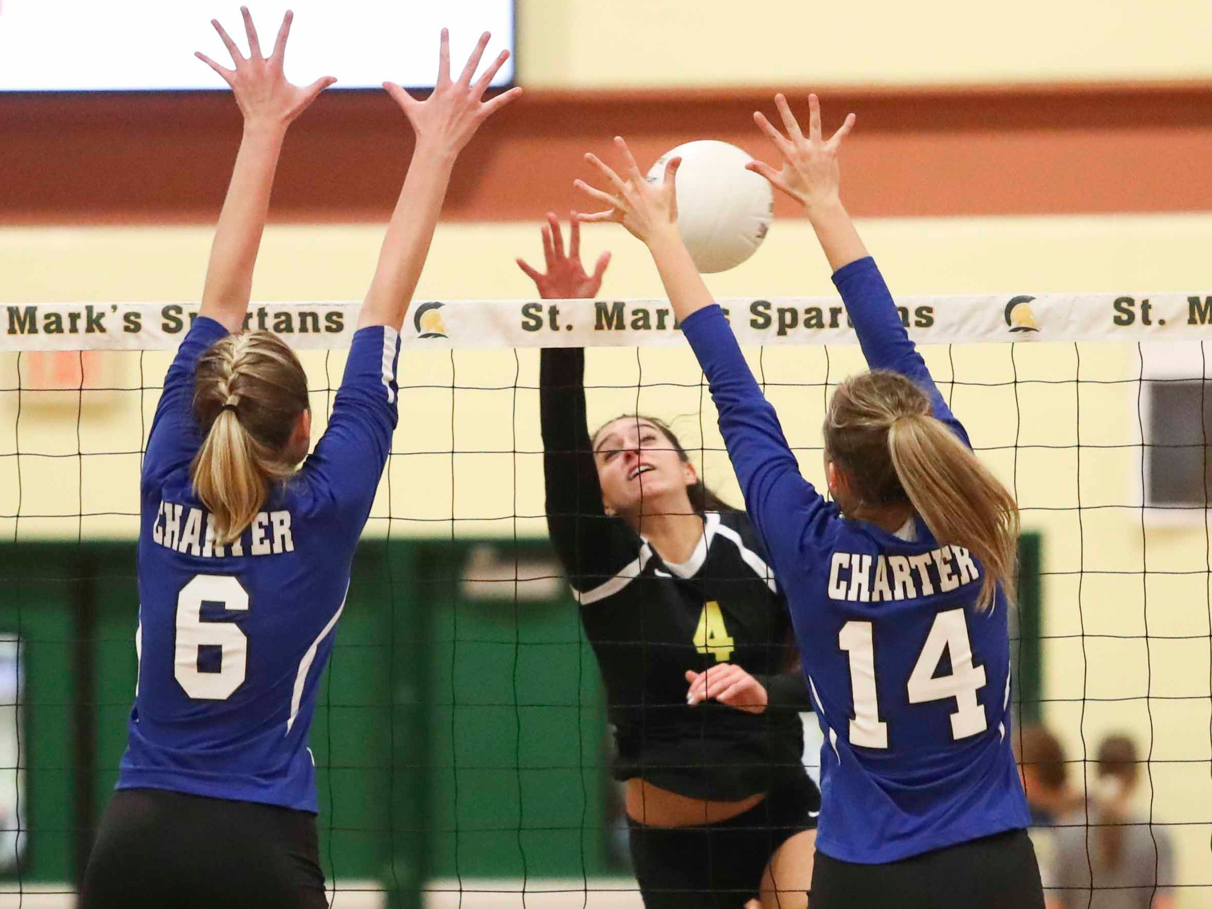 Padua's Jacqueline Camponelli (4) tries to hit past Charter School of Wilmington's Madeline Matheny (6) and Danielle Waltz as the Force advances to Monday's final in the DIAA state tournament Thursday at St. Mark's High School.