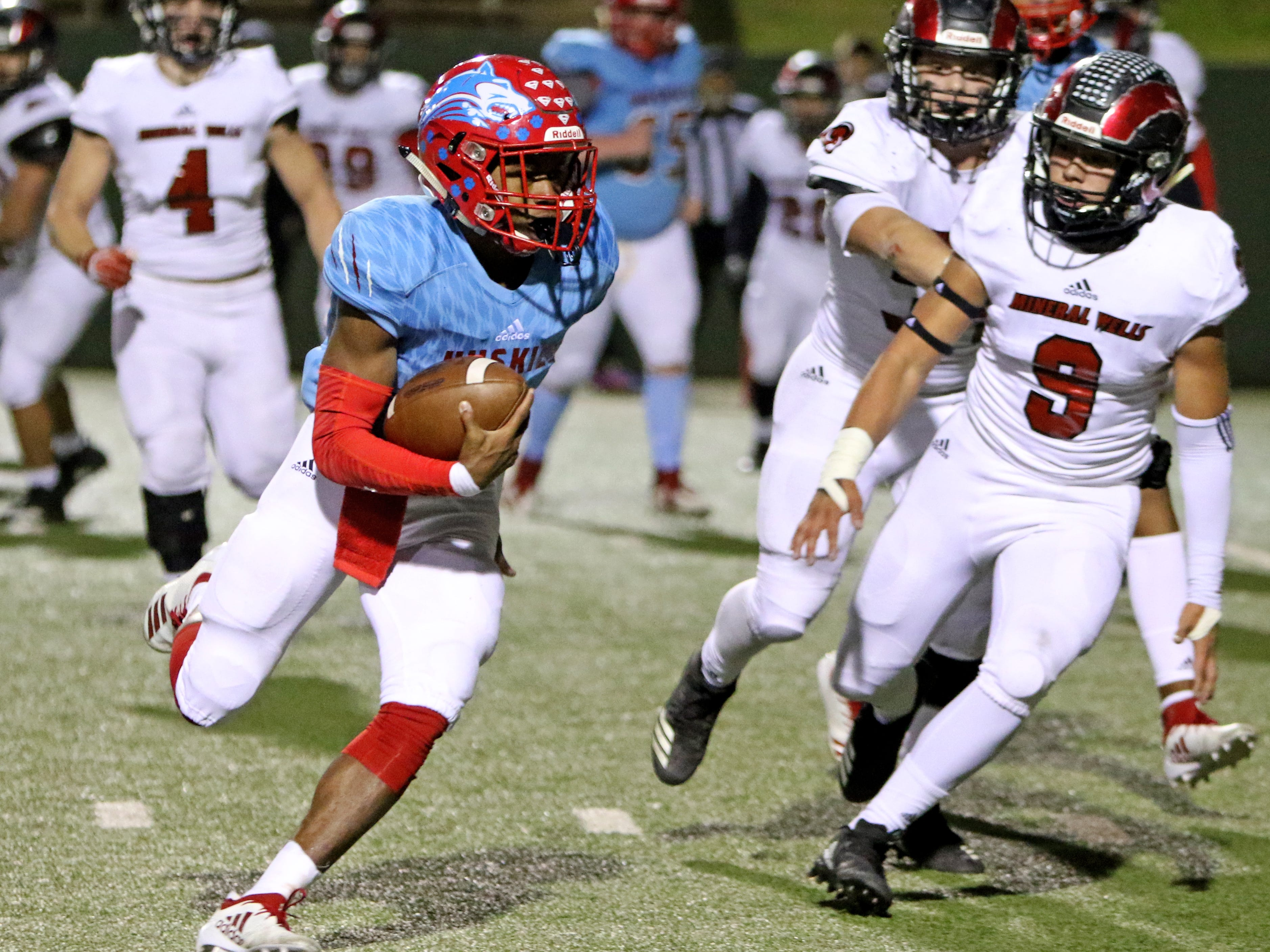 Hirschi's Nathan Downing runs for a two-point conversion against Mineral Wells Thursday, Nov. 8, 2018, at Memorial Stadium. The Huskies defeated the Rams 41-20.