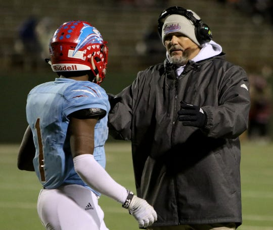 Hirschi head football coach Danny Youngs talks to Daimarqua Foster in the game against Mineral Wells Thursday, Nov. 8, 2018, at Memorial Stadium. The Huskies defeated the Rams 41-20.