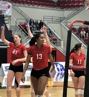 Christ Academy won the TAPPS 1A State Championship Friday with a 24-26, 25-10, 25-8, 25-15 win over Bellville Faith.  Danielle Okeke and Morgan Brasher point up to the crowd after tying the match at one set apiece.