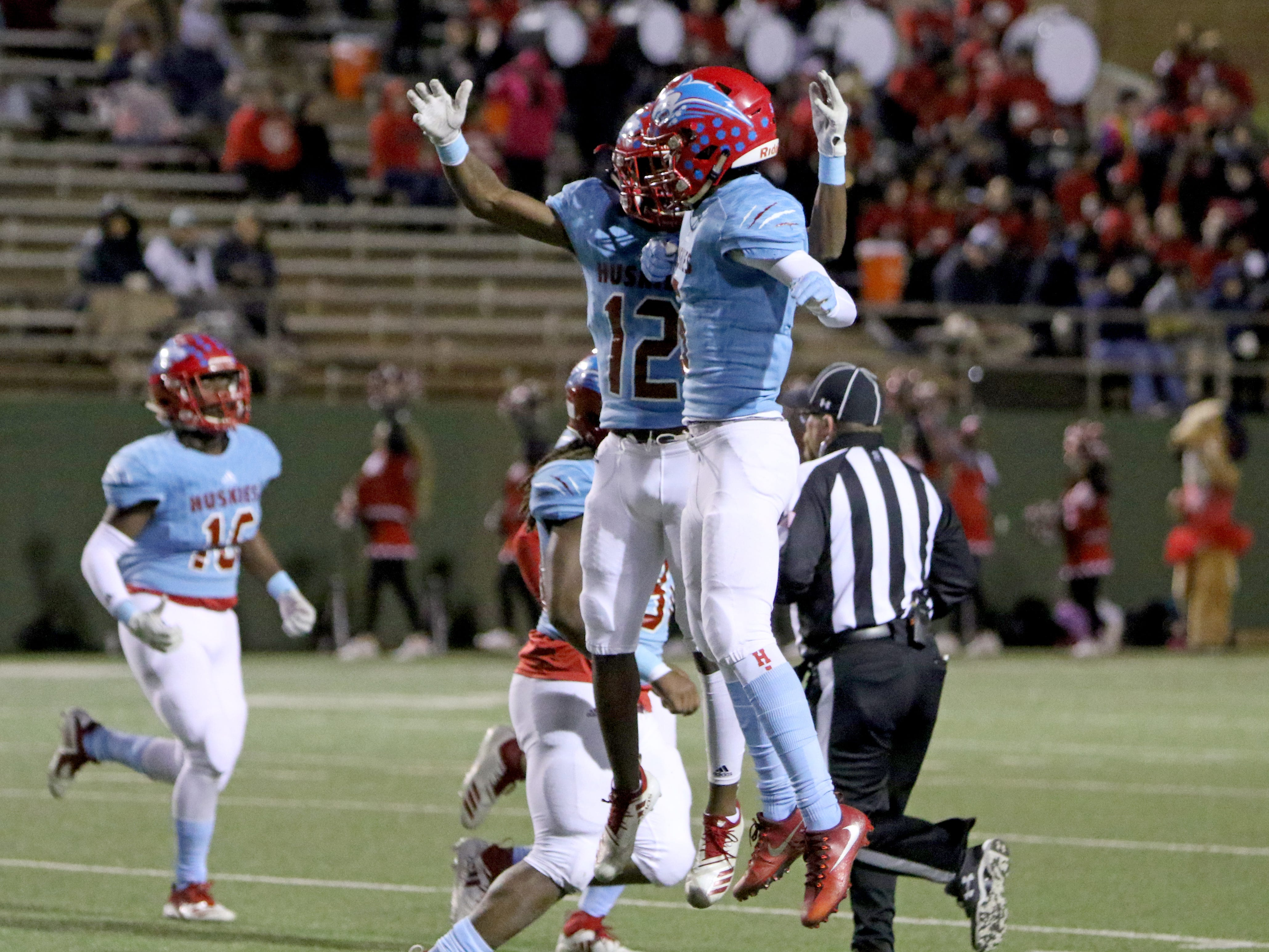 Hirschi's Stavonte Vaughn (12) and Kenta Manuel celebrate recovering the onside kick against Mineral Wells Thursday, Nov. 8, 2018, at Memorial Stadium. The Huskies defeated the Rams 41-20.