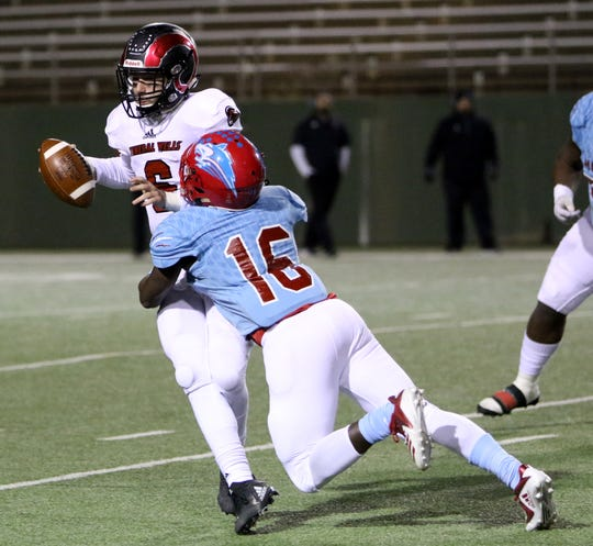 Hirschi's Sammy Walker sacks Mineral Wells' Drew Huff Thursday, Nov. 8, 2018, at Memorial Stadium. The Huskies defeated the Rams 41-20.