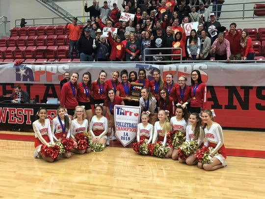 Christ Academy players, cheerleaders and fan support gather to celebrate the school's TAPPS 1A State Volleyball championship Friday, Nov. 9, 2018.