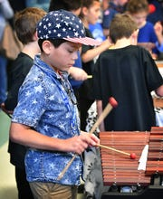 Tower Elementary fifth grader Vincent Perez plays percussion during a Veterans Day program at the school Friday.