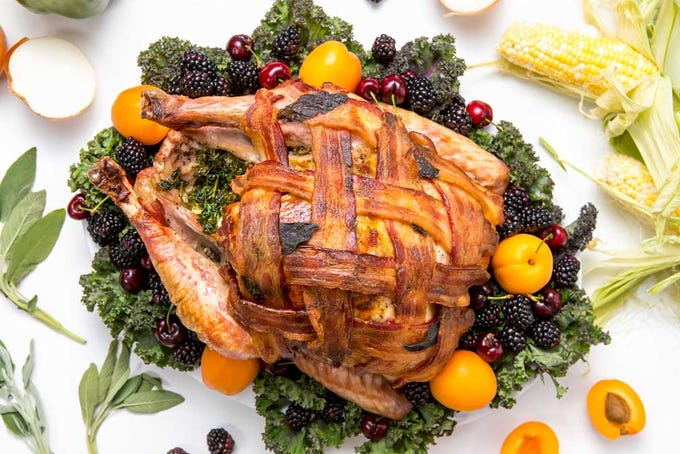 Tired of your usual Thanksgiving turkey recipe? Give your holiday bird a bacon-wrapped update, with this recipe inspired by Better Homes & Gardens, and watch your family and friends drool when you bring it to the table!