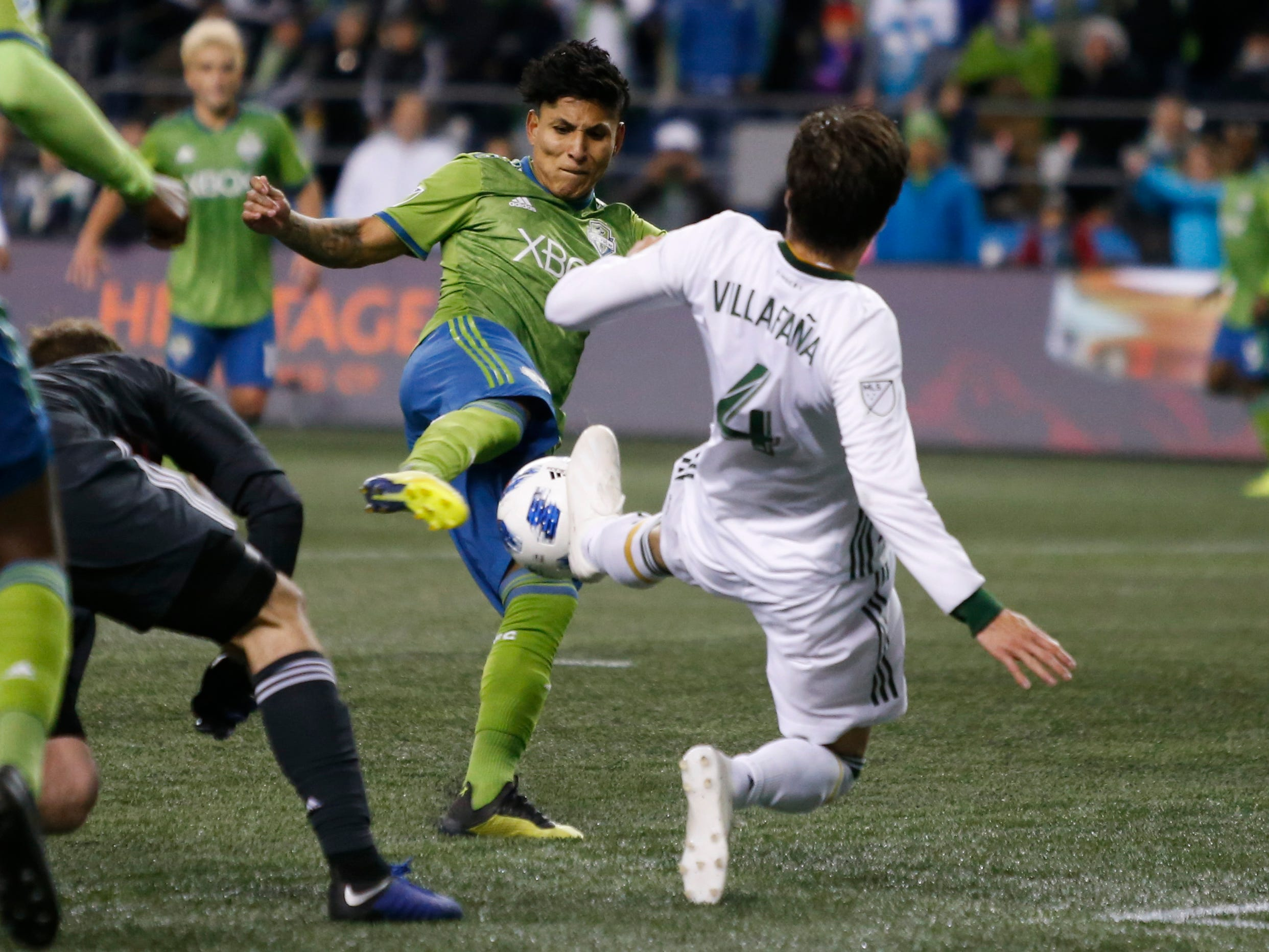 Seattle Sounders FC forward Raul Ruidiaz puts a shot past Portland Timbers defender Jorge Villafana (4) for a goal during the second half at CenturyLink Field.
