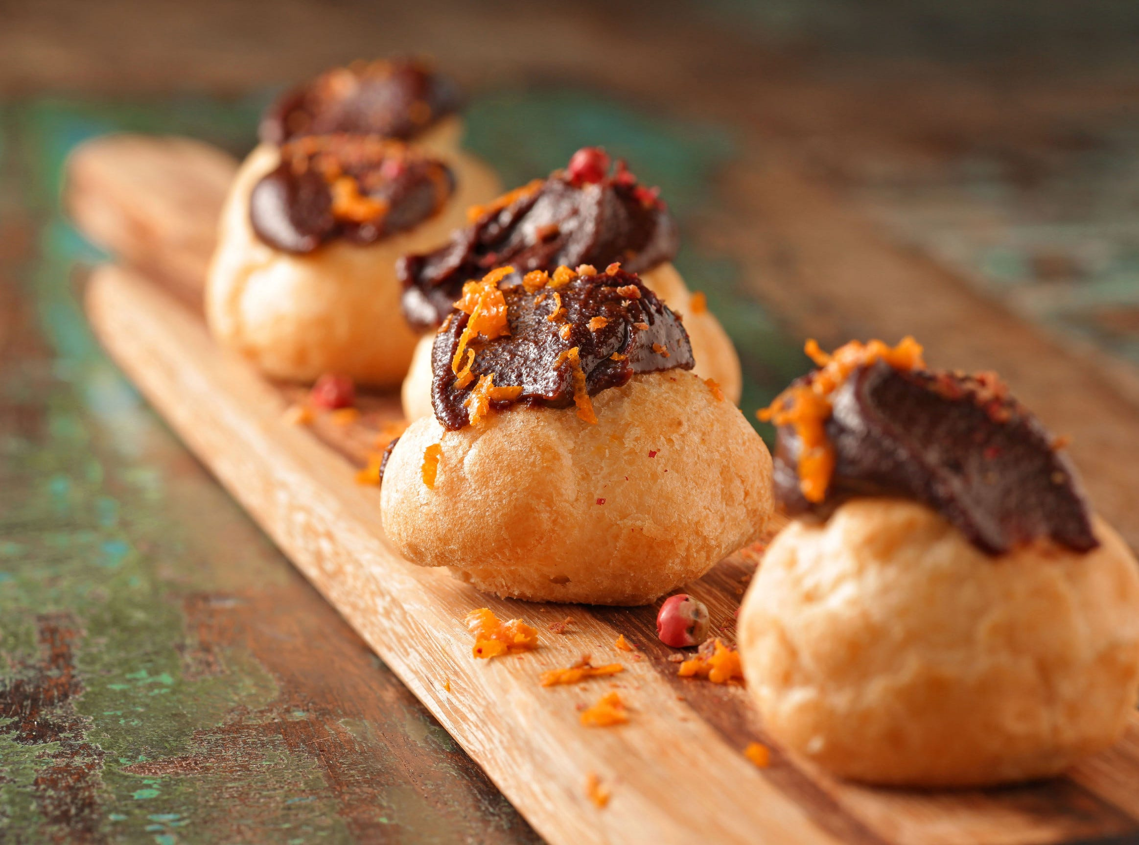 These profiteroles with their spicy, chocolaty cannoli filling make for a sensational autumn or winter dessert, and can be offered alongside — or instead of — traditional holiday desserts.
