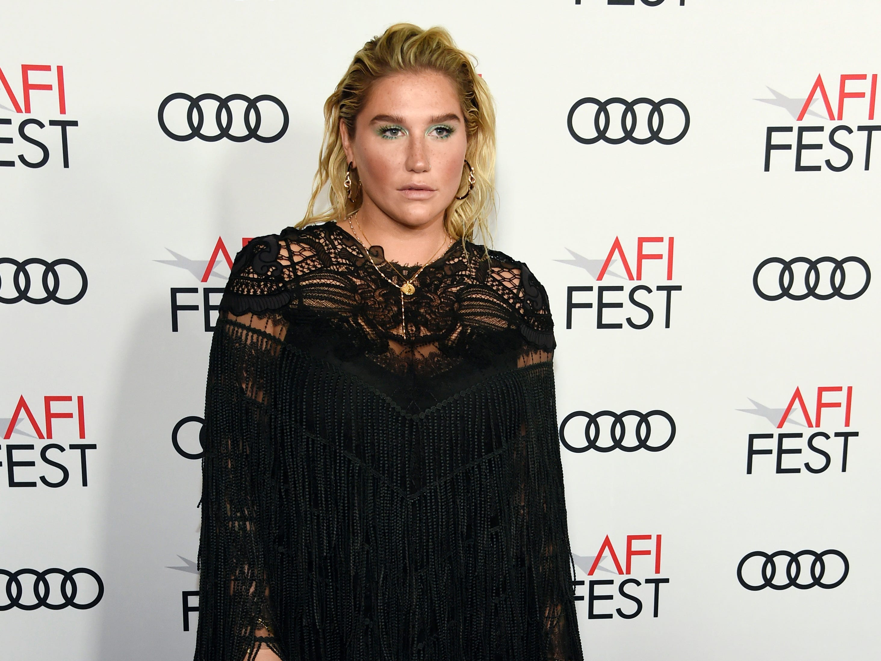"Singer Kesha, whose song ""Here Comes the Change"" is featured in ""On the Basis of Sex,"" poses at the premiere of the film on the opening night of the 2018 AFI Fest, Thursday, Nov. 8, 2018, in Los Angeles. (Photo by Chris Pizzello/Invision/AP) ORG XMIT: CACP112"