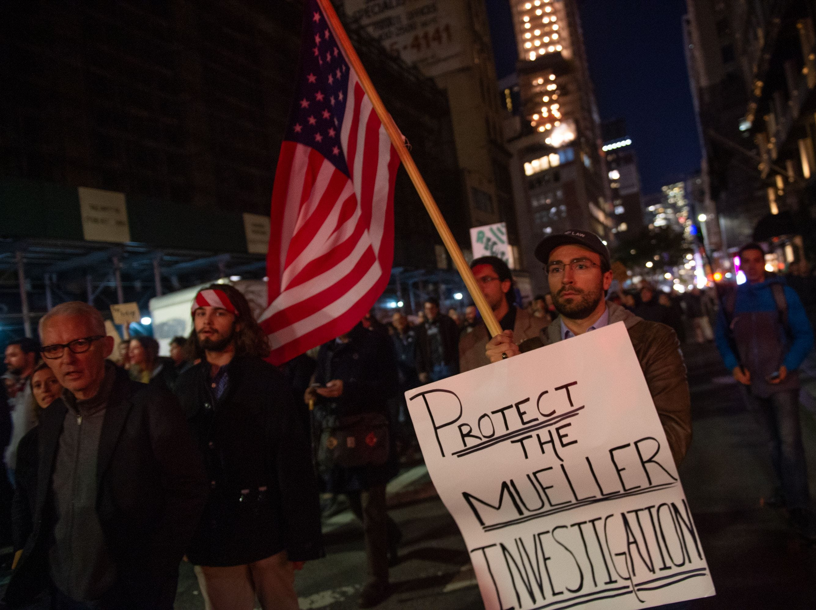 People protest and march against US President Donald Trump's alleged interference in Robert Mueller's investigation in New York City on November 8, 2018.