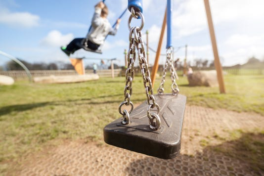 Empty Playground Swing