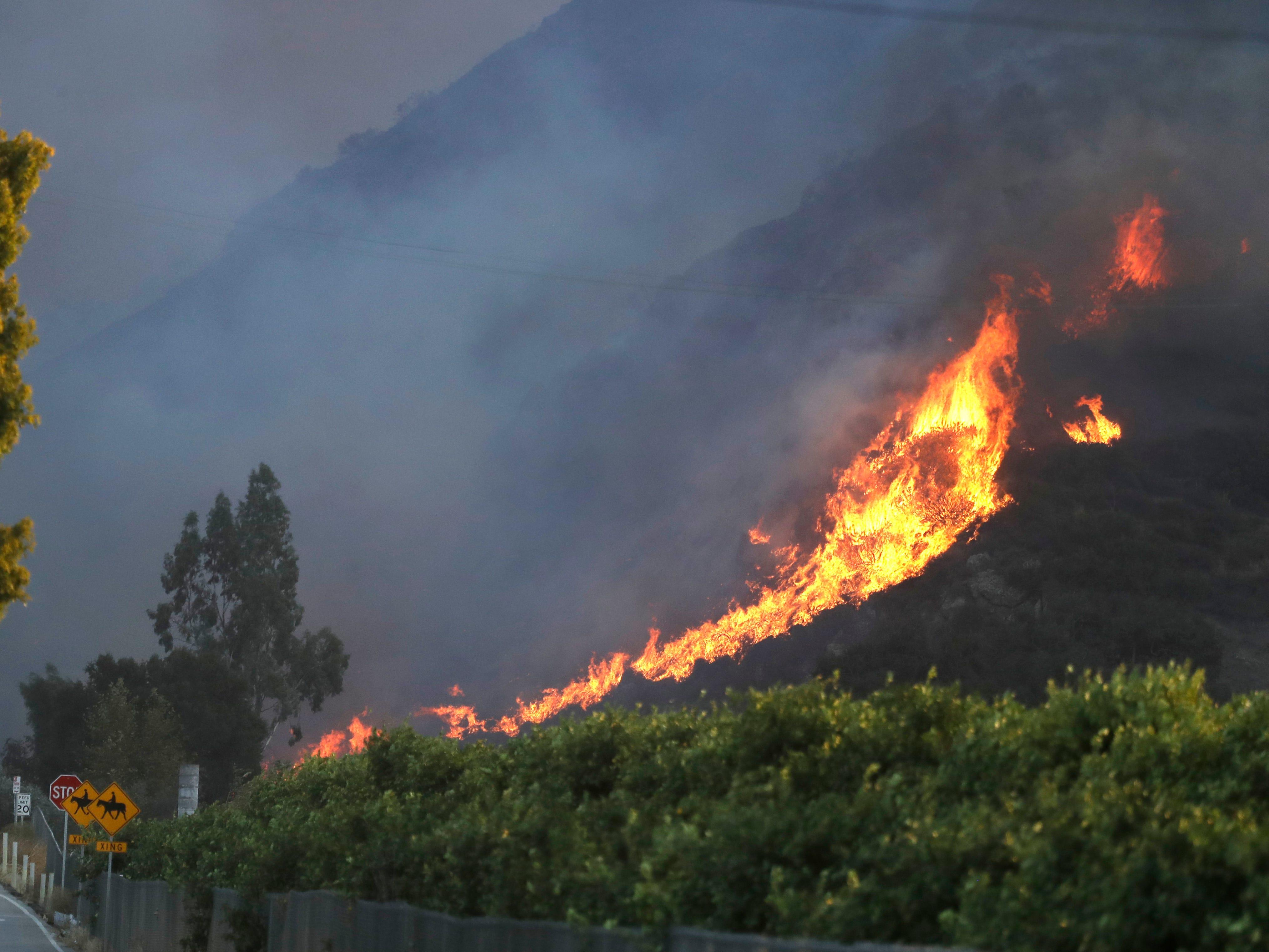 A wildfire burns on Nov. 8, 2018, near Newbury Park, Calif.