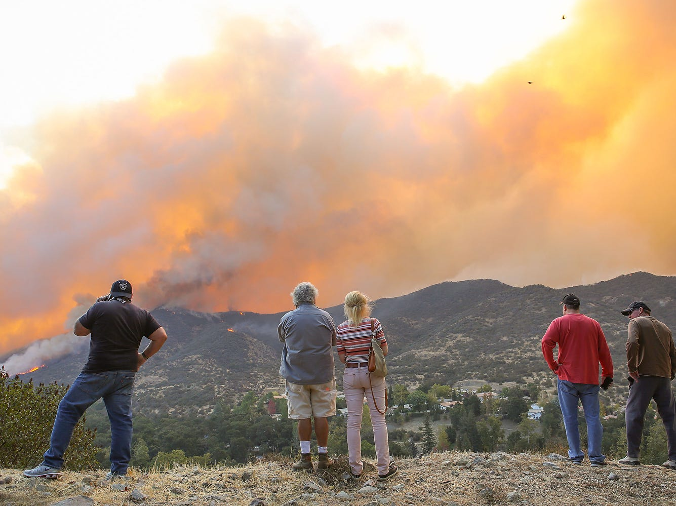 Residents of Westlake Village, Calif. watch the Woolsey Fire as it surrounds Triunfo Canyon on Friday.