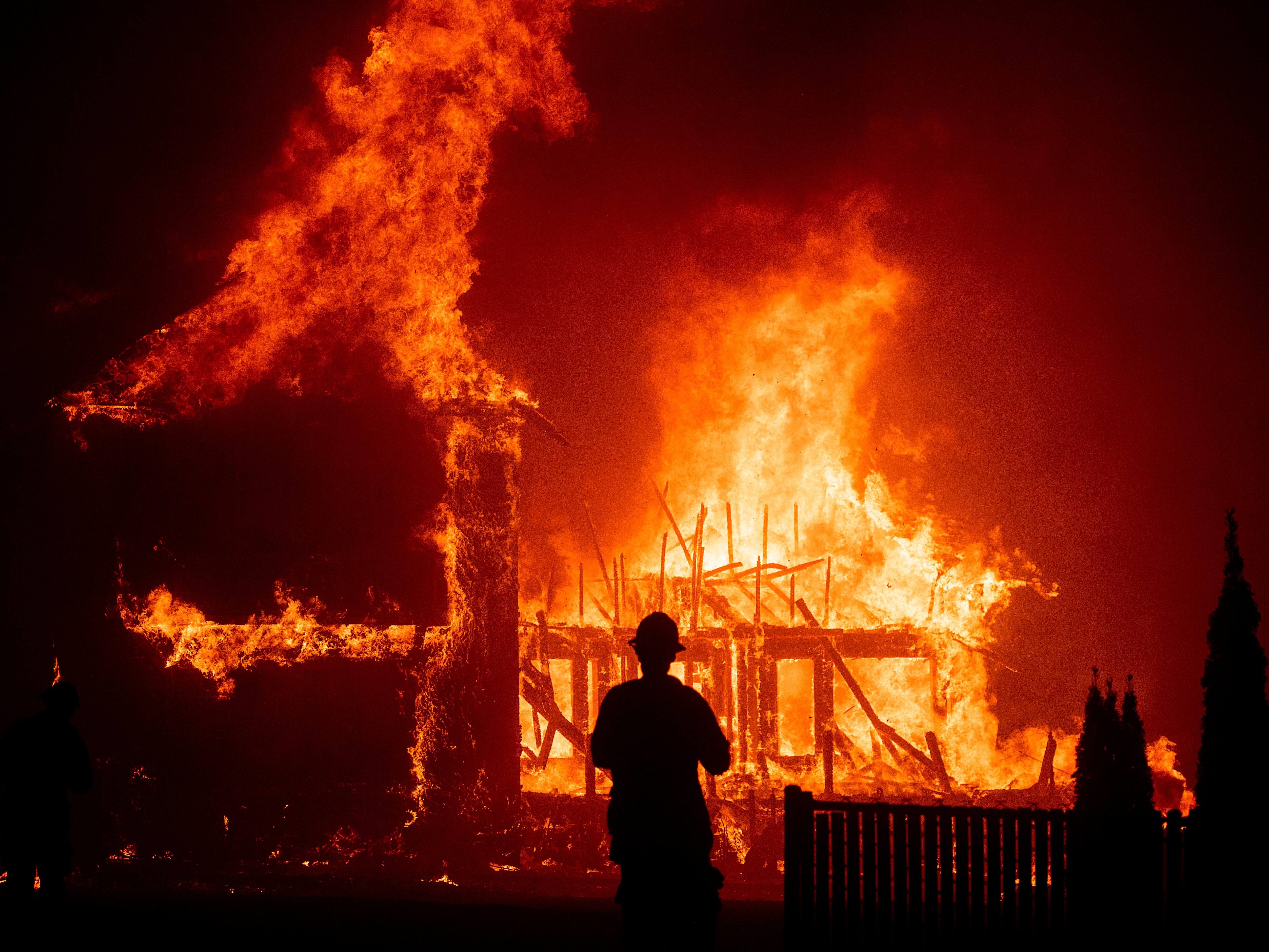 A home burns as the Camp Fire rages through Paradise, Calif., on Nov. 8, 2018.