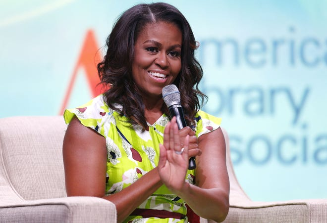 Former first lady Michelle Obama criticizes President Trump and talks about her relationship with her husband, former President Barack Obama, in her new book, 'Becoming.'