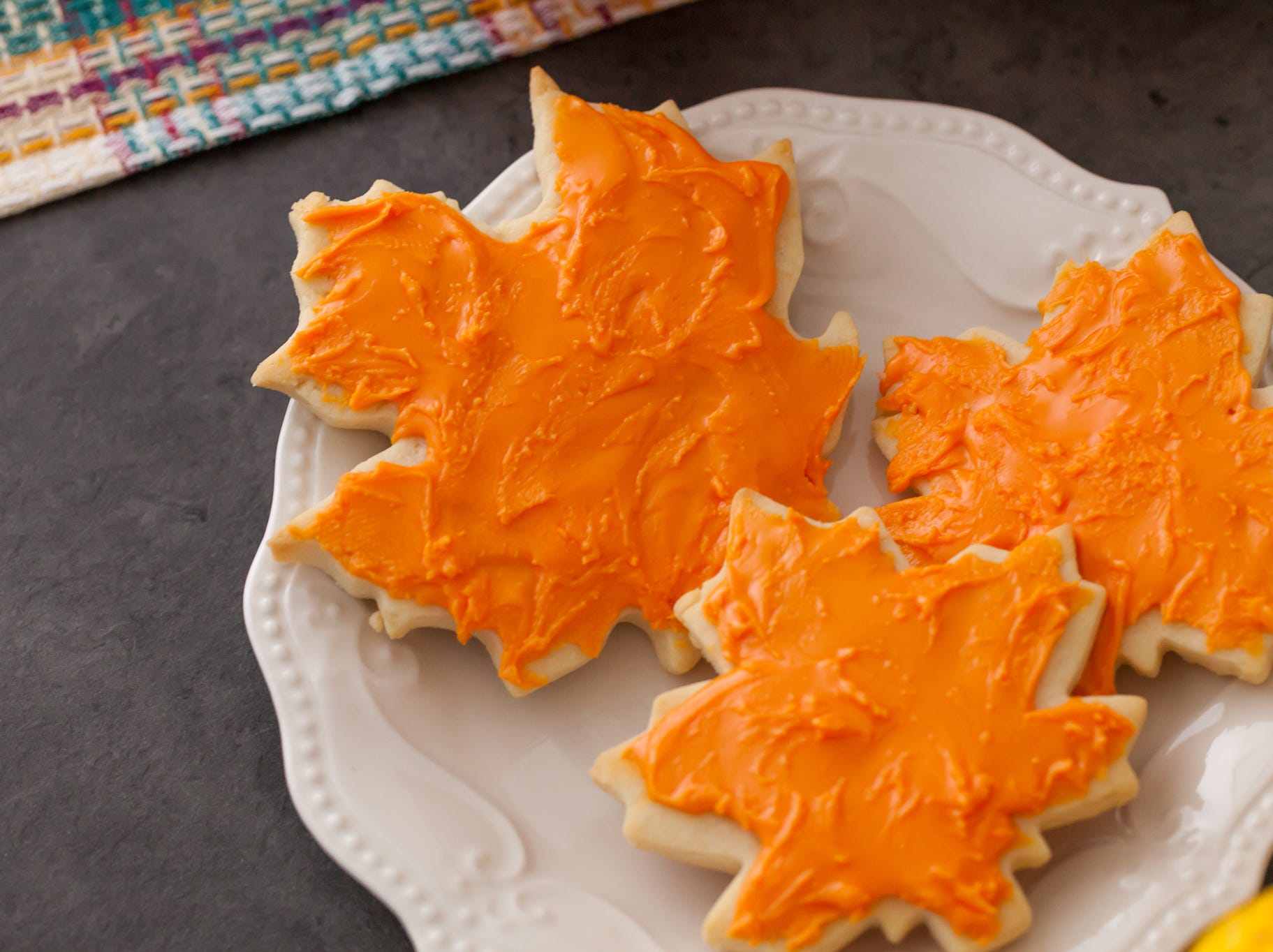 Nothing conjures up images of a lovely fall day better than brightly-colored leaves — which makes these maple leaf cookies the perfect autumn treat!
