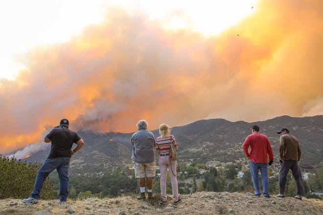 Residents of Westlake Village, Calif.watch the Woolsey Fire as it surrounds Triunfo Canyon Nov. 9, 2018.